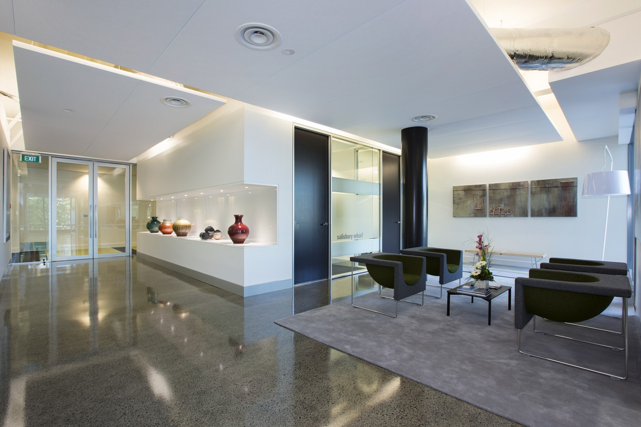 To create a cost-effective reception area for Staples architecture, ceiling, floor, interior design, lobby, real estate, gray