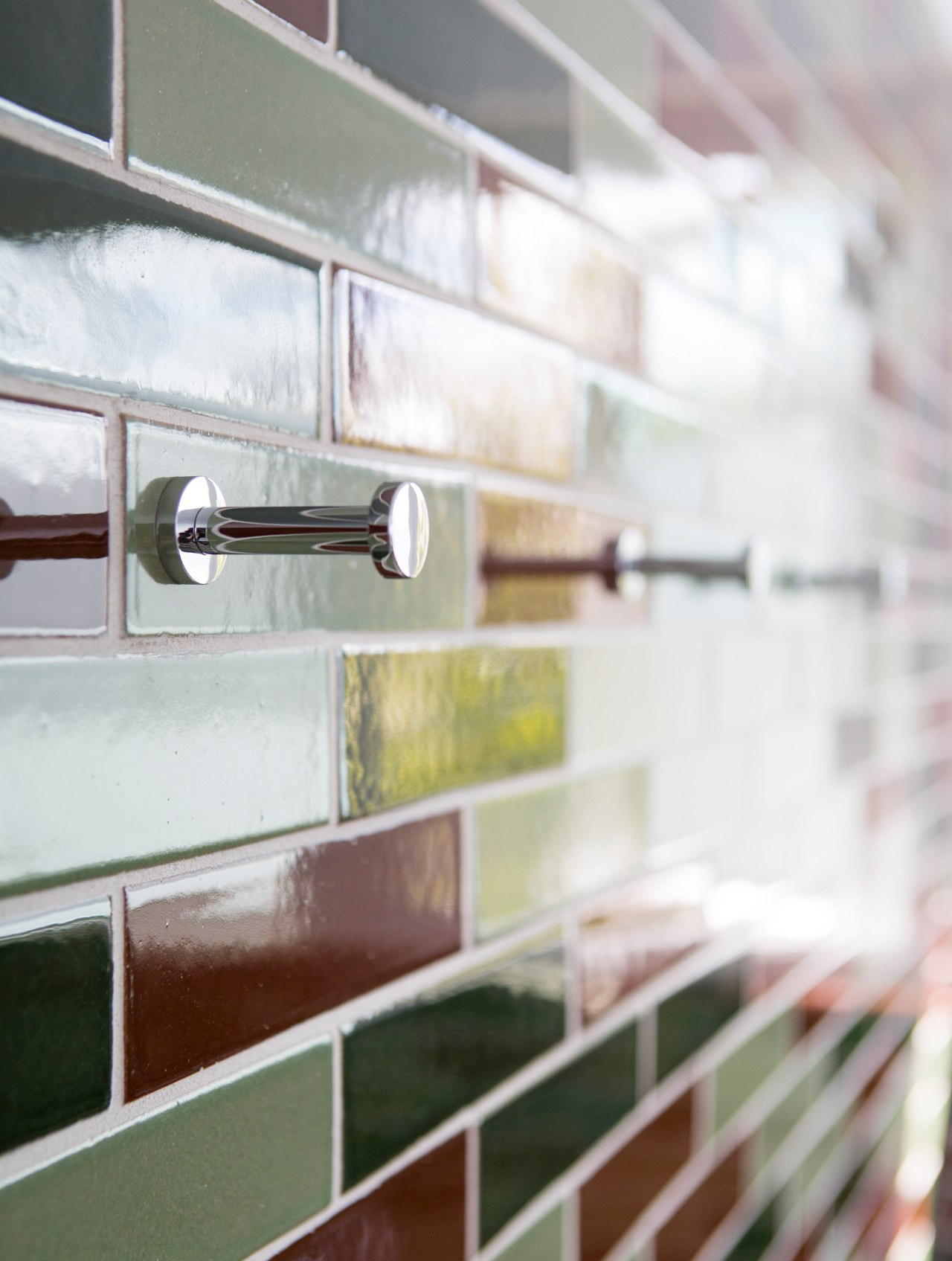 Detail of a tiled wall with towel hooks. floor, furniture, glass, shelf, shelving, wall, window, wood, white