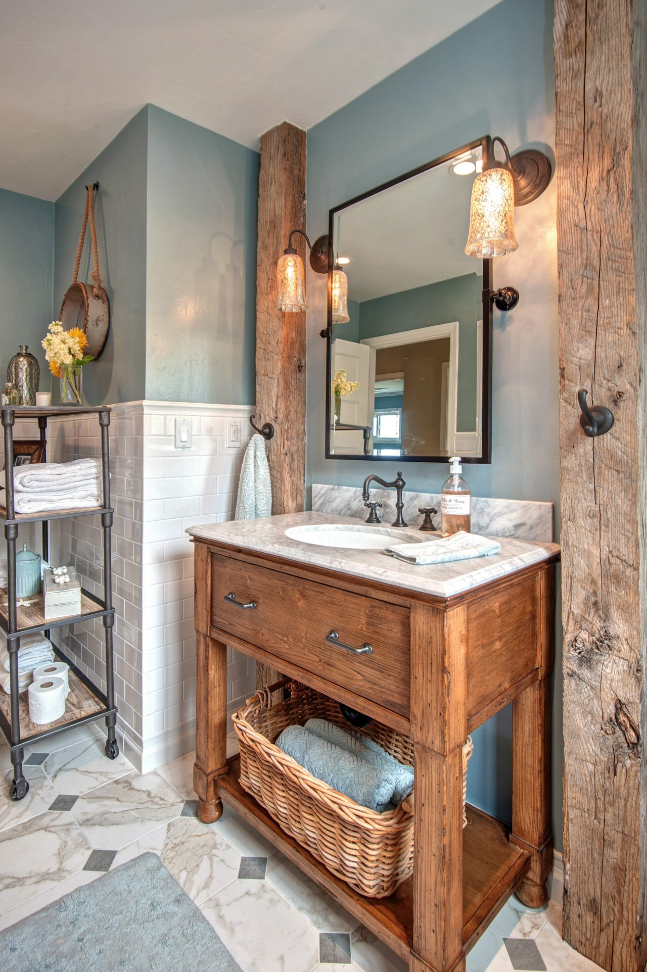 This modest guest bathroom celebrates a relaxed seaside bathroom, bathroom cabinet, cabinetry, countertop, interior design, room, gray