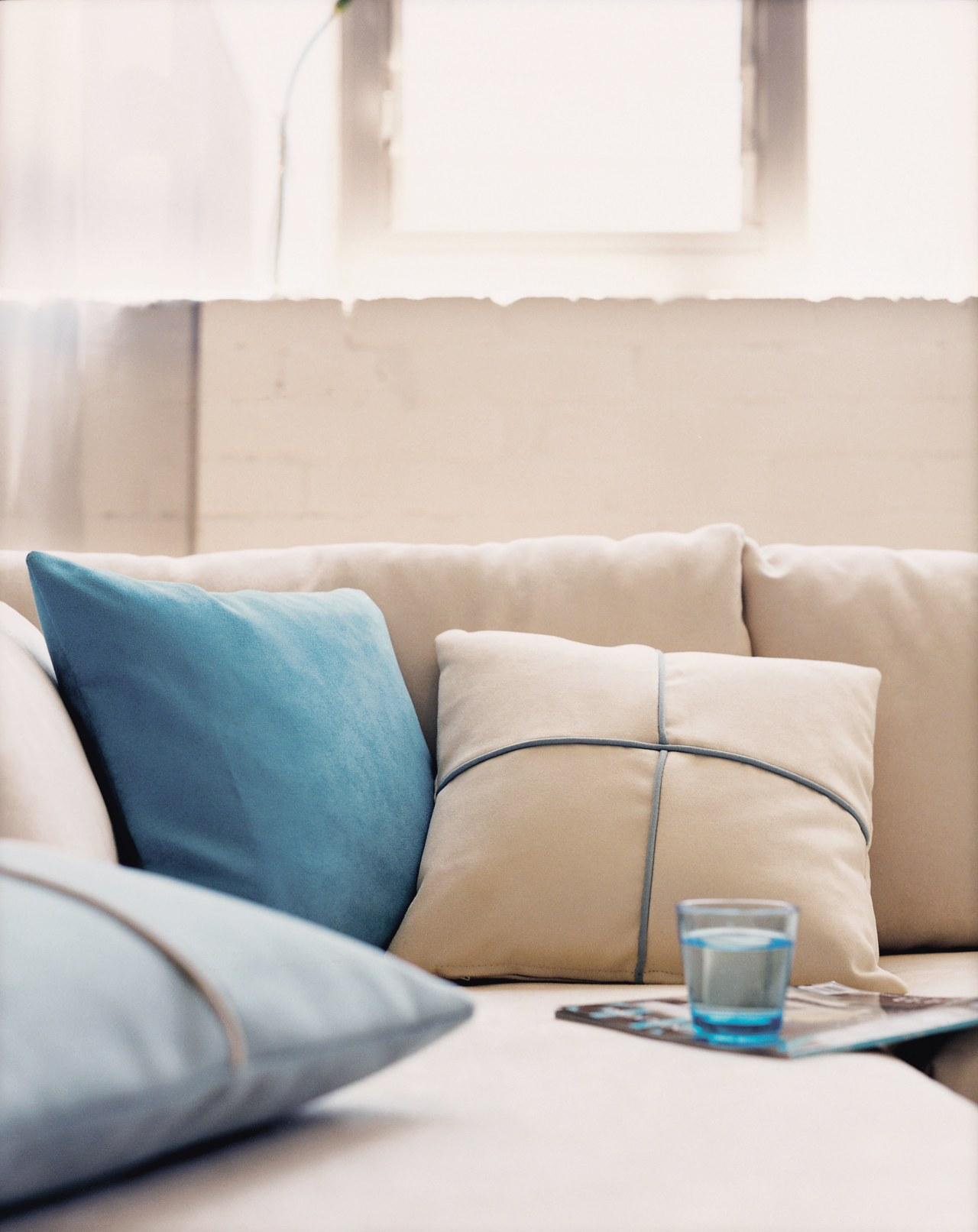In modern commercial interiors, an eye-catching furnishing scheme bed sheet, bedding, couch, cushion, duvet cover, furniture, interior design, linens, living room, pillow, product design, room, textile, white