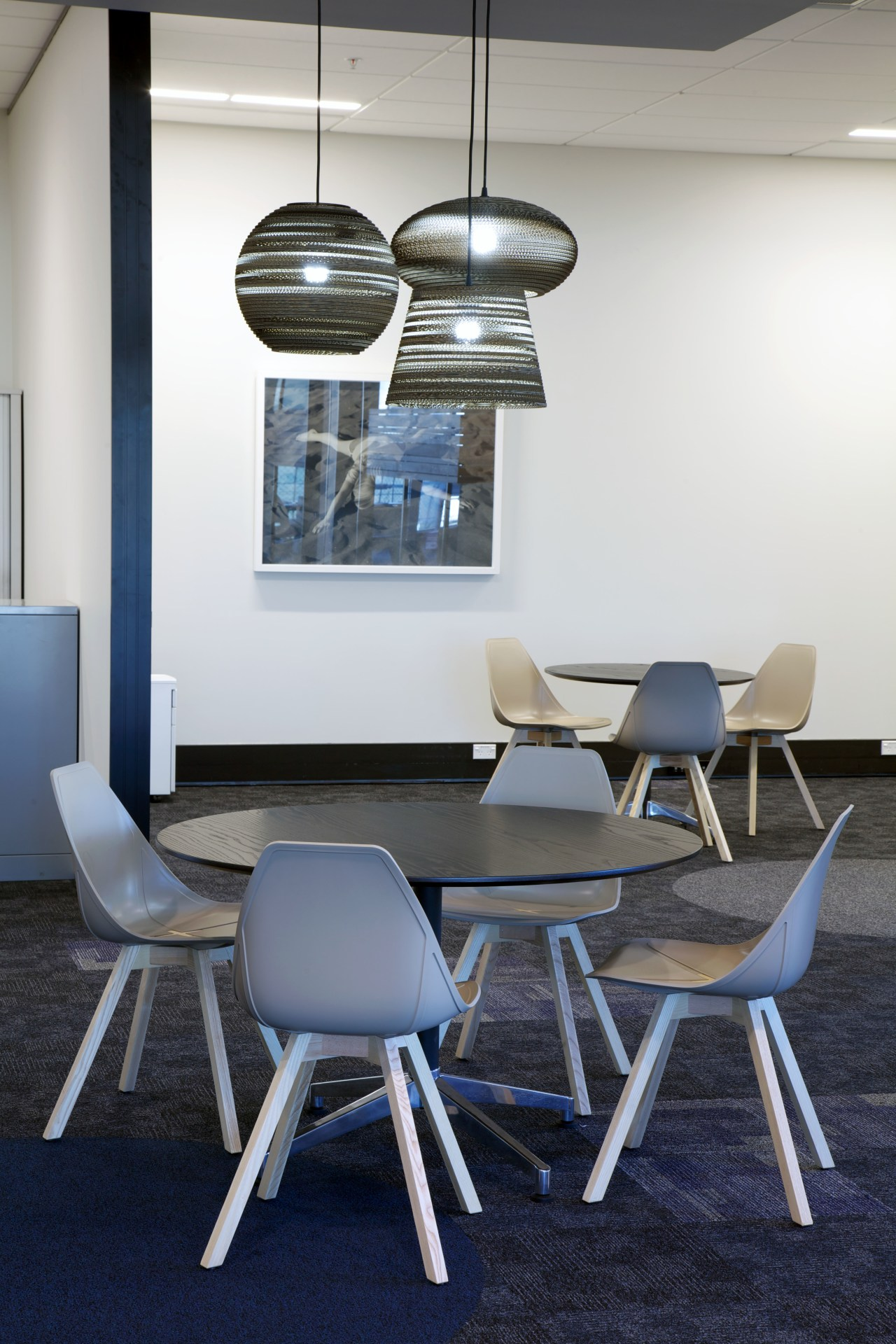 This commercial interior reflects a professional business with architecture, ceiling, chair, dining room, furniture, interior design, light fixture, office, product design, table, gray, white