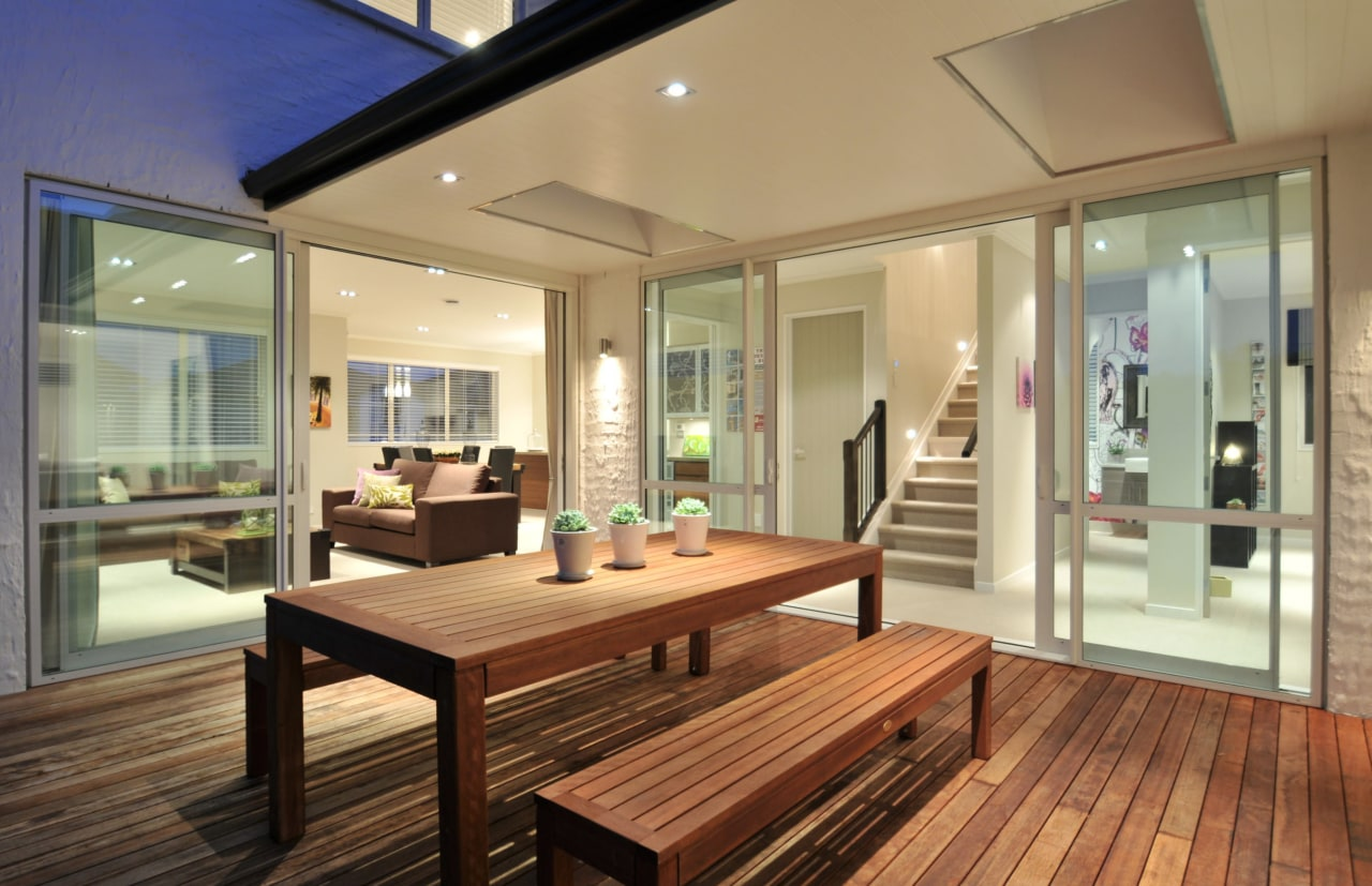 Outdoor living areas are a key part of hardwood, house, interior design, property, real estate, window, wood, brown, orange