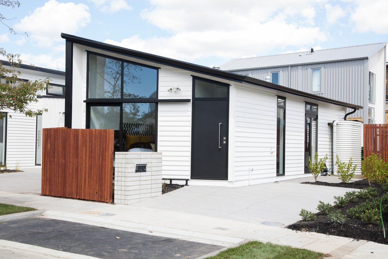 This new home is one of three houses building, facade, home, house, property, real estate, white