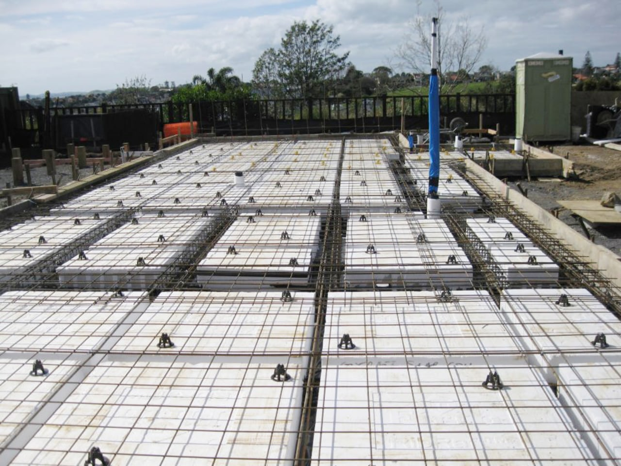Ceiling and wall insulation with concrete pad composite material, construction, structure, white, gray