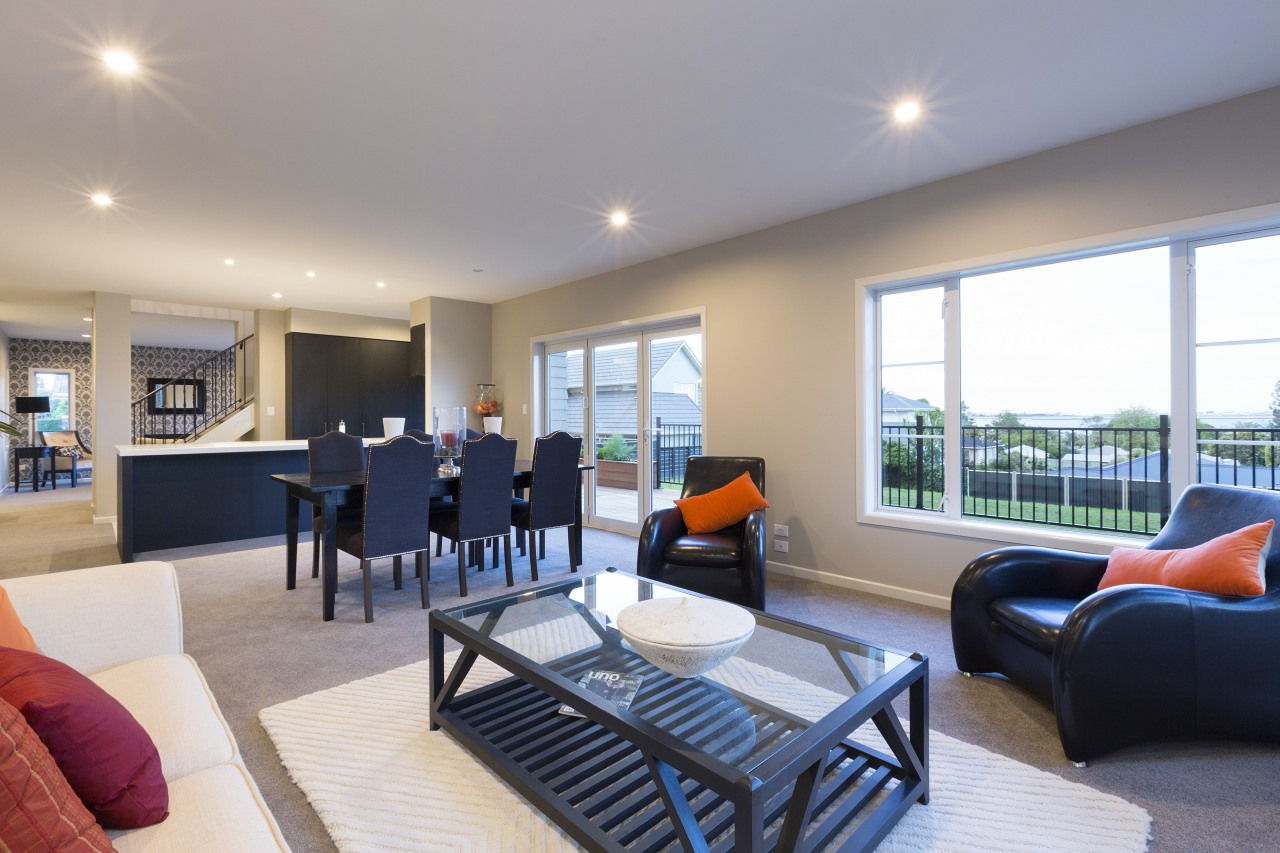 Formal and informal living areas are separated by home, house, interior design, living room, property, real estate, room, gray