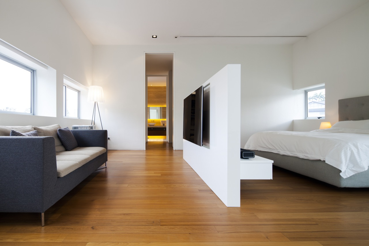 A freestanding wall divides this master suite and architecture, bed, bed frame, bedroom, ceiling, floor, flooring, furniture, hardwood, interior design, laminate flooring, real estate, room, suite, wood, wood flooring, gray