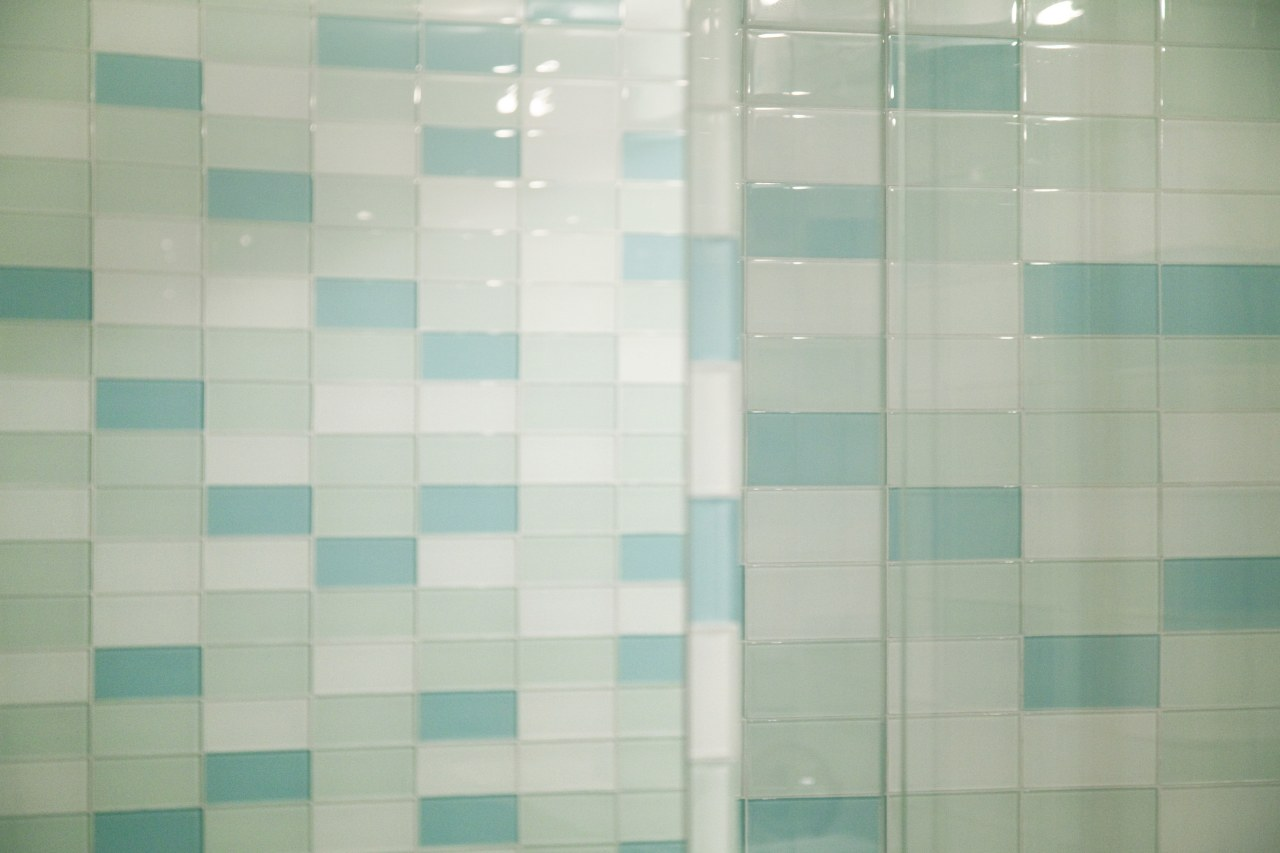 Both of these factors influenced the design of blue, daylighting, floor, flooring, green, line, pattern, square, texture, tile, turquoise, wall, gray