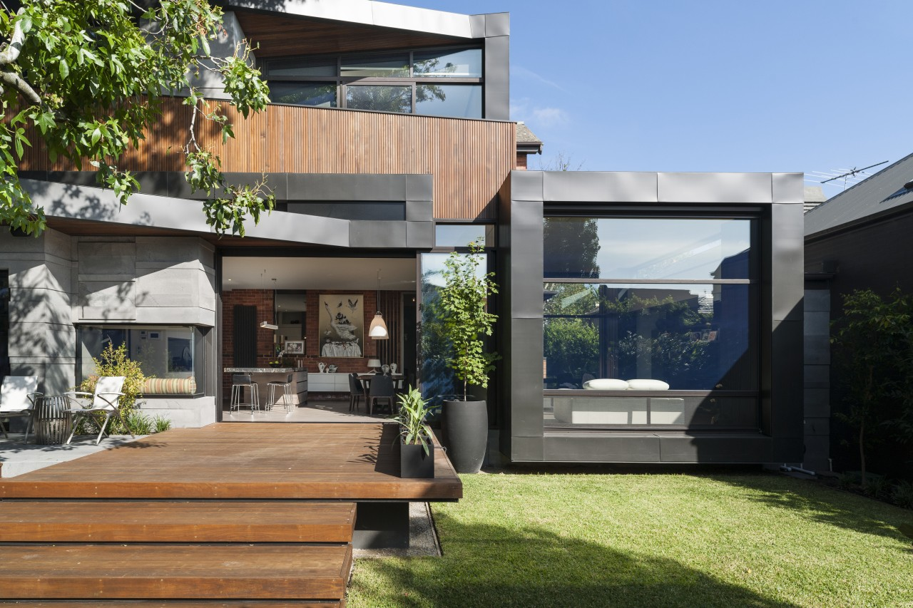 The rear of this renovated home is a architecture, backyard, courtyard, estate, facade, home, house, property, real estate, residential area, yard, black