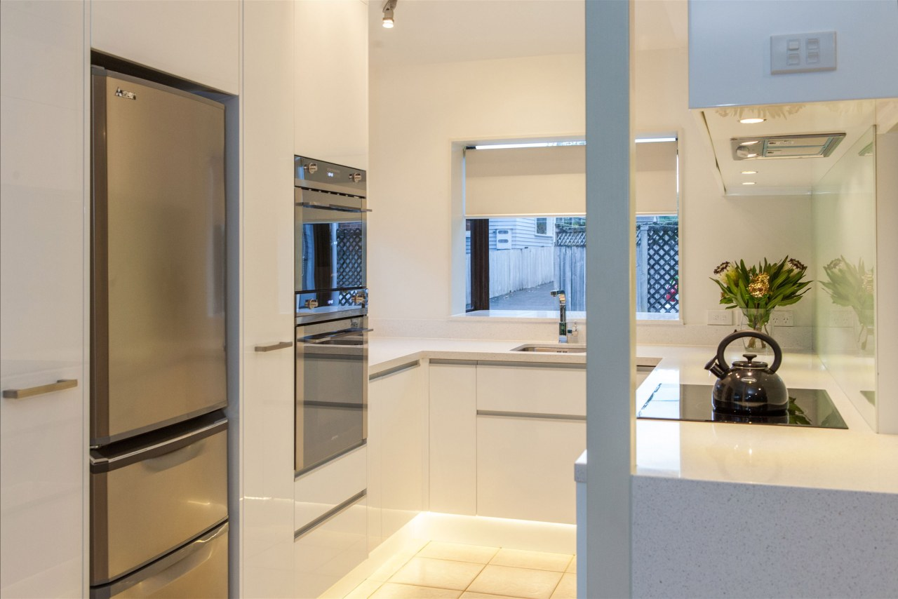 This small kitchen was completely transformed by kitchen countertop, home appliance, interior design, kitchen, real estate, room, orange