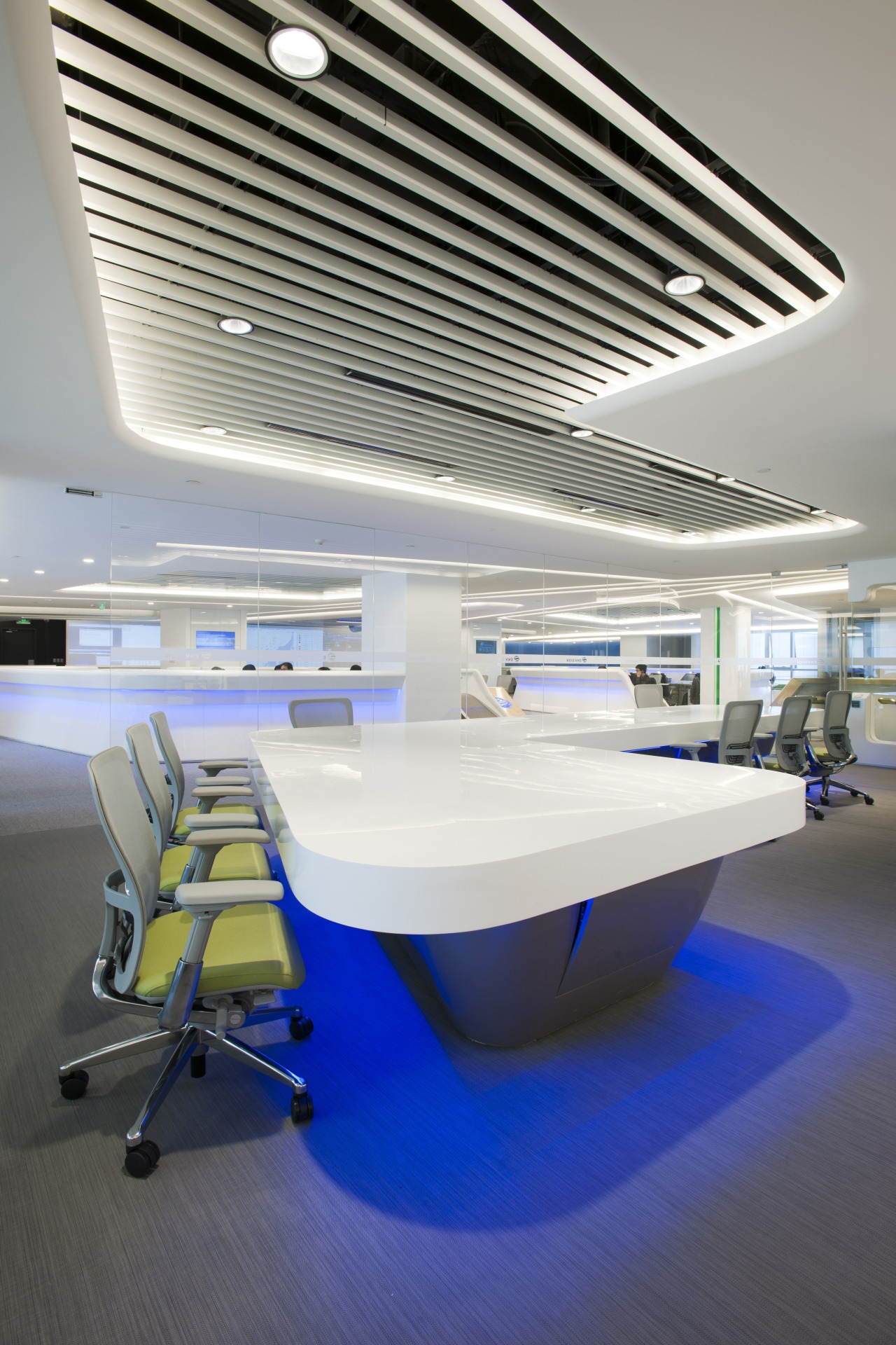 Exposed portions of the ceiling mimic the shape architecture, ceiling, daylighting, furniture, interior design, lighting, office, product design, table, gray