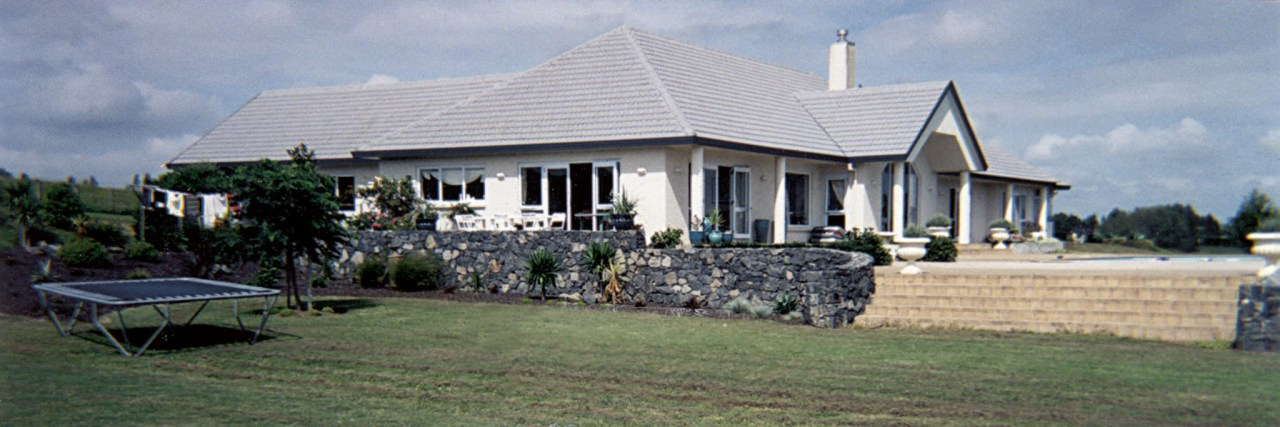 Before the renovation, the house had a more cottage, estate, farmhouse, home, house, mansion, property, real estate, roof, villa, gray