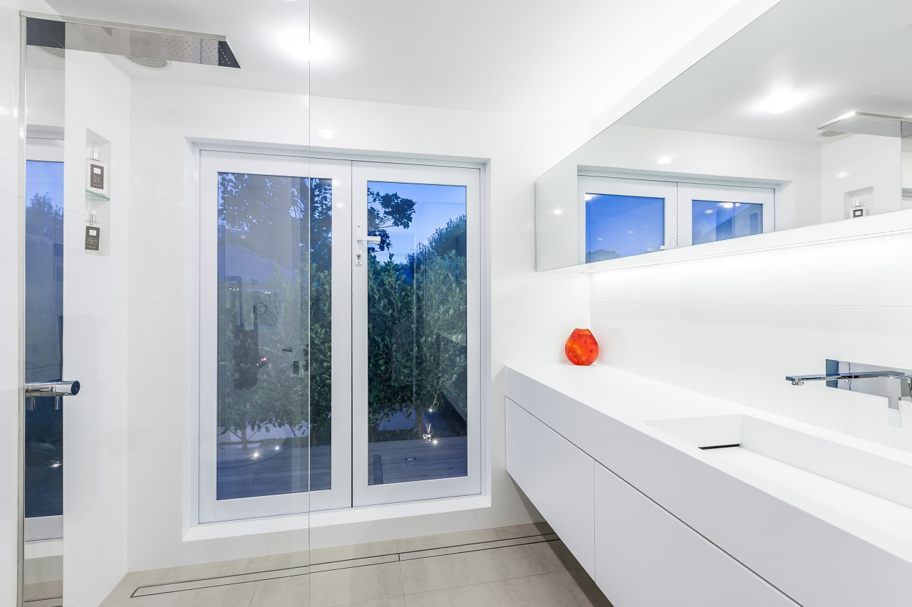 This white bathroom by designer Celia Visser took bathroom, interior design, real estate, room, window, white