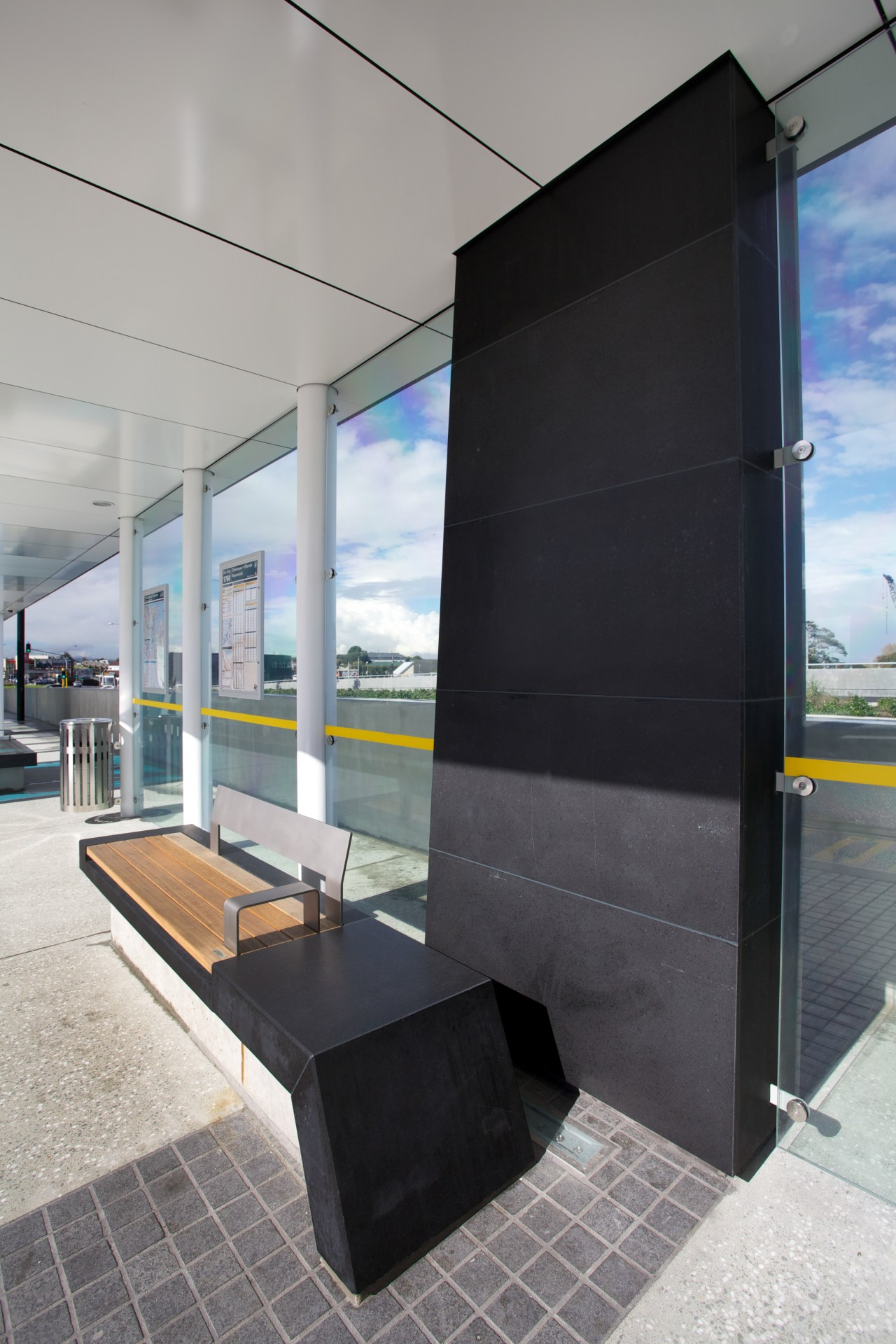 Basalt from SCE Stone & Design clads structural architecture, glass, window, gray, black