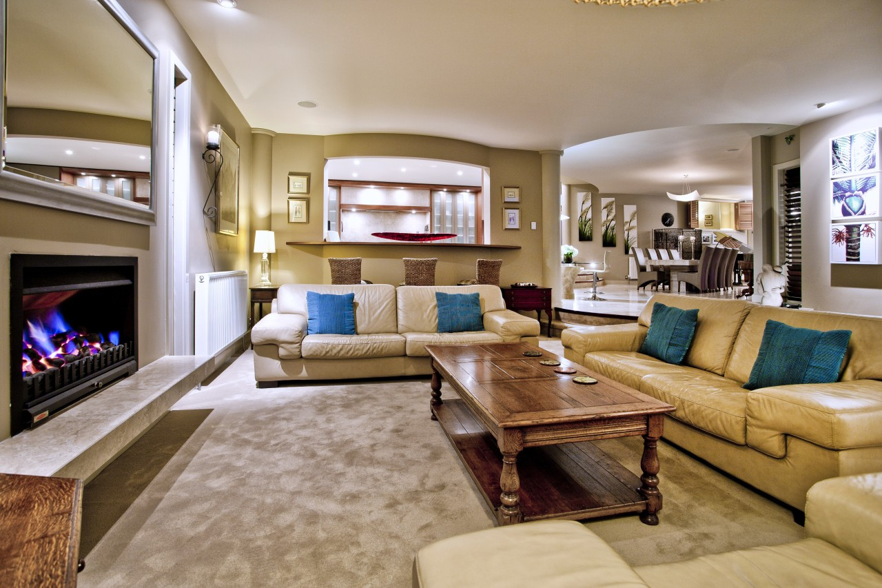 Formal living room with leather sofas and gas ceiling, estate, home, interior design, living room, property, real estate, room, brown, orange