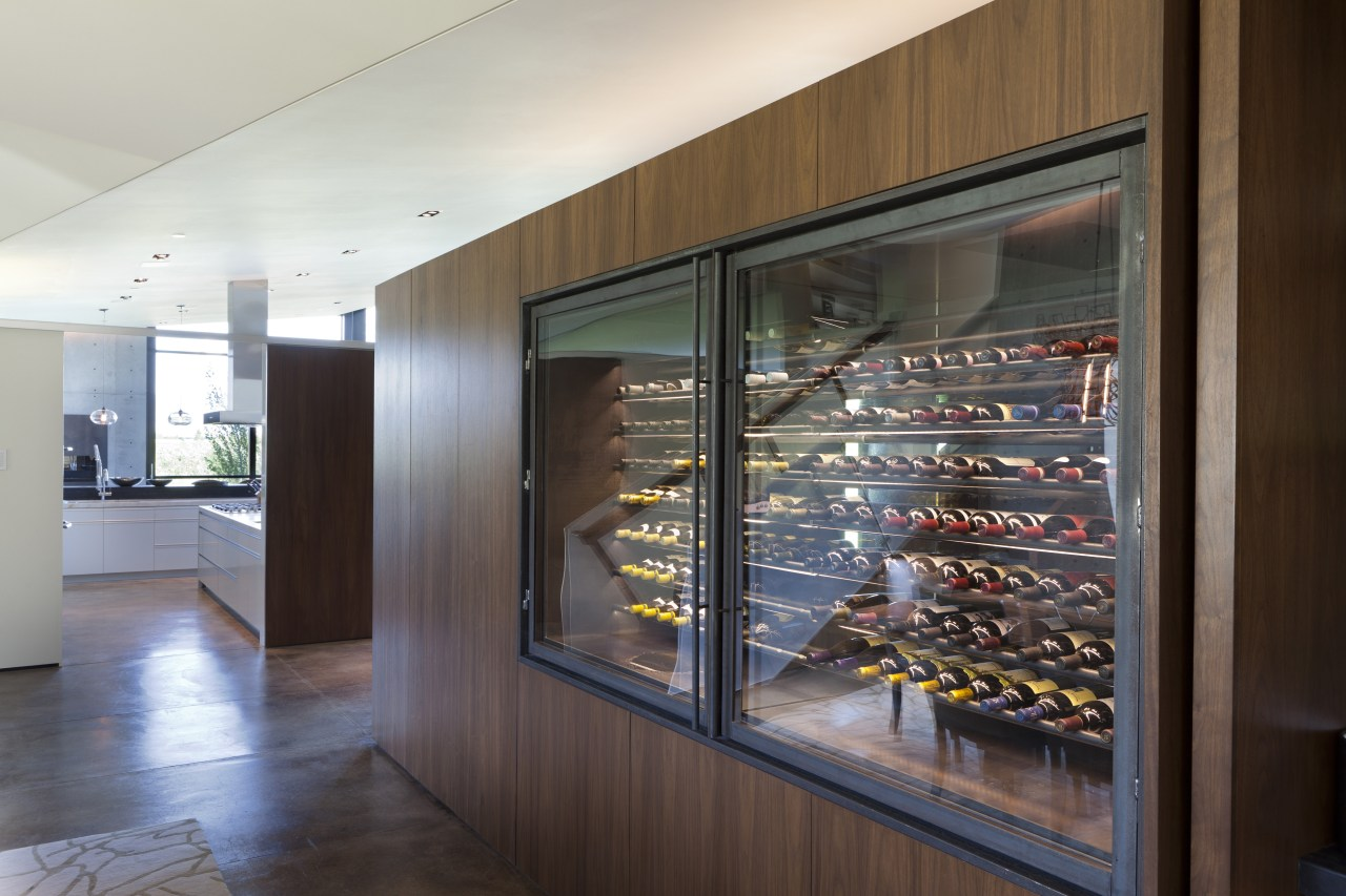 The walnut cabinet which contains a refrigerated wine display case, interior design, gray