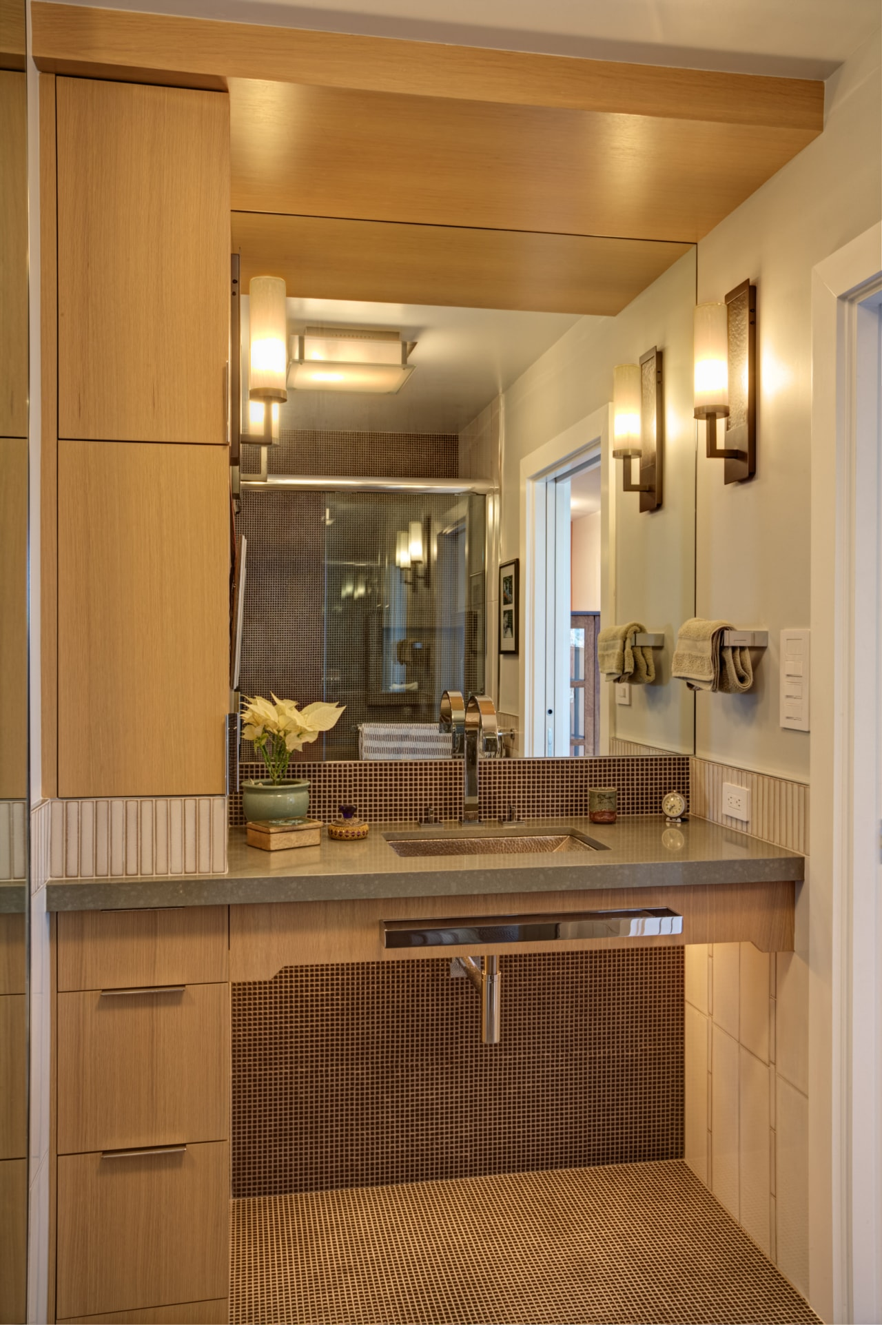 The tiled guest bathroom has an artisanal feel. cabinetry, countertop, interior design, kitchen, room, brown, orange