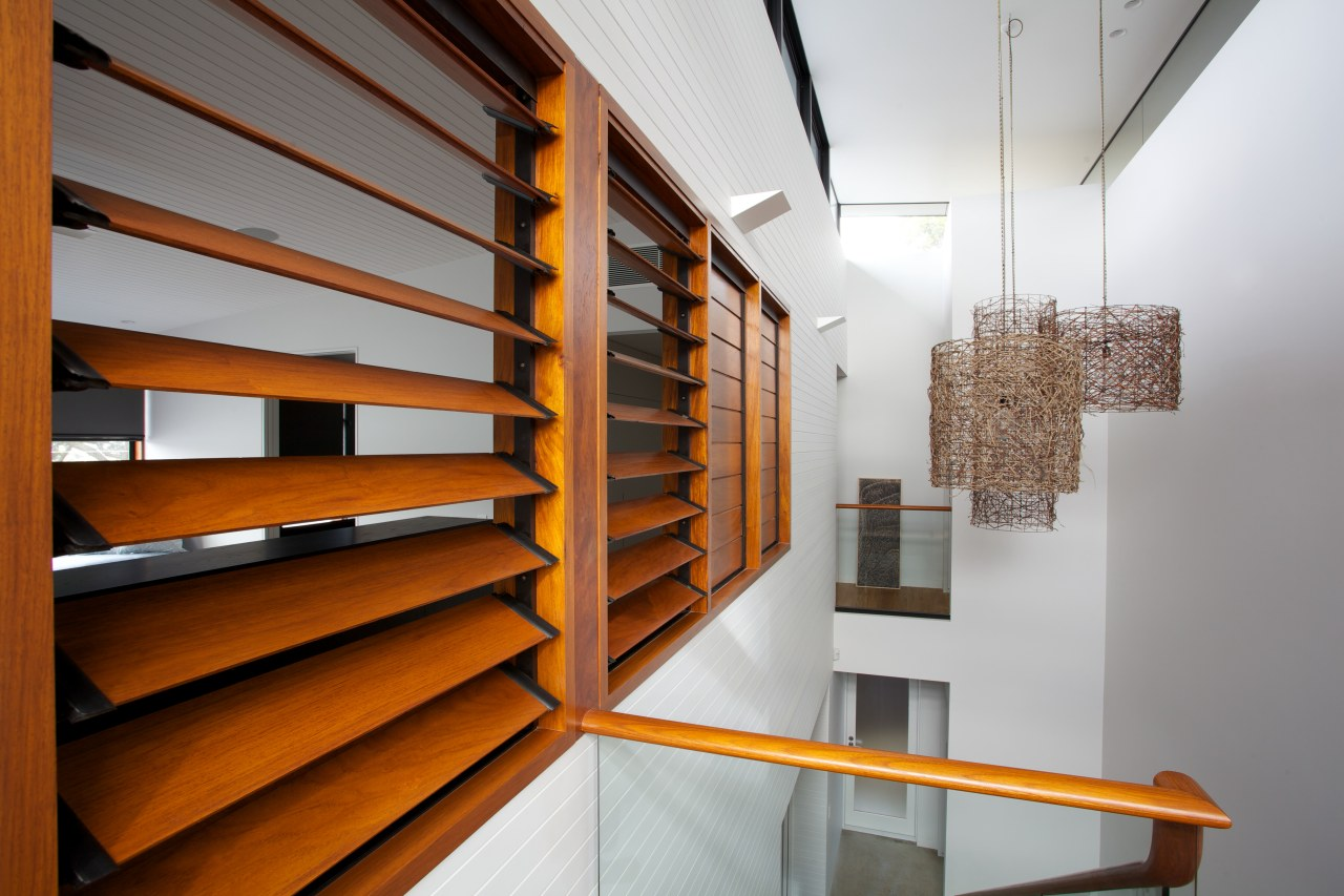 Detail of internal wooden louvres. architecture, daylighting, handrail, interior design, shelf, shelving, stairs, wood, gray, brown