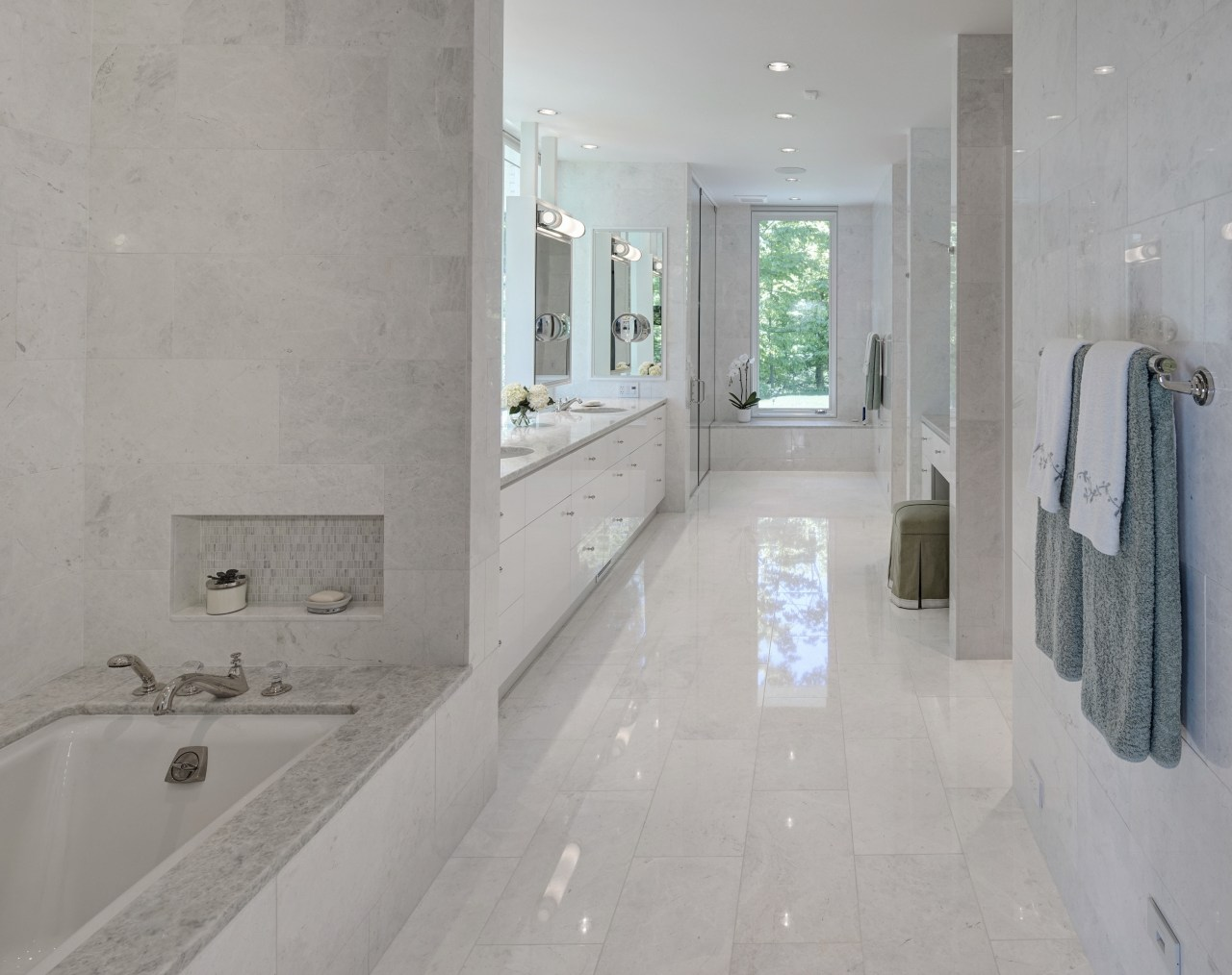 Reflective surfaces were specified to create a tranquil, bathroom, estate, floor, flooring, home, interior design, plumbing fixture, property, real estate, room, tile, wall, gray