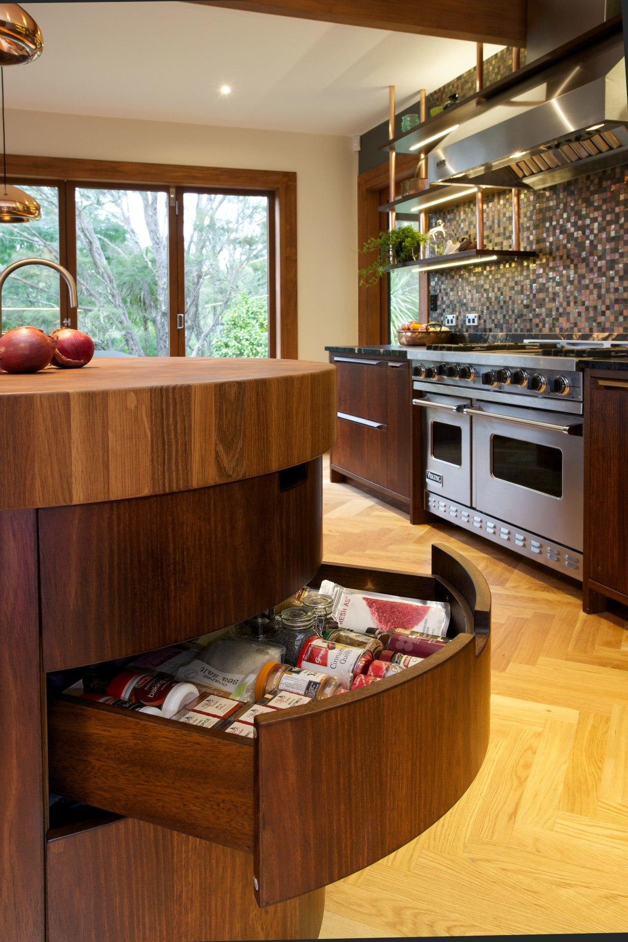 The wooden butchers block is one of many cabinetry, countertop, floor, flooring, hardwood, interior design, kitchen, living room, room, wood, brown, orange