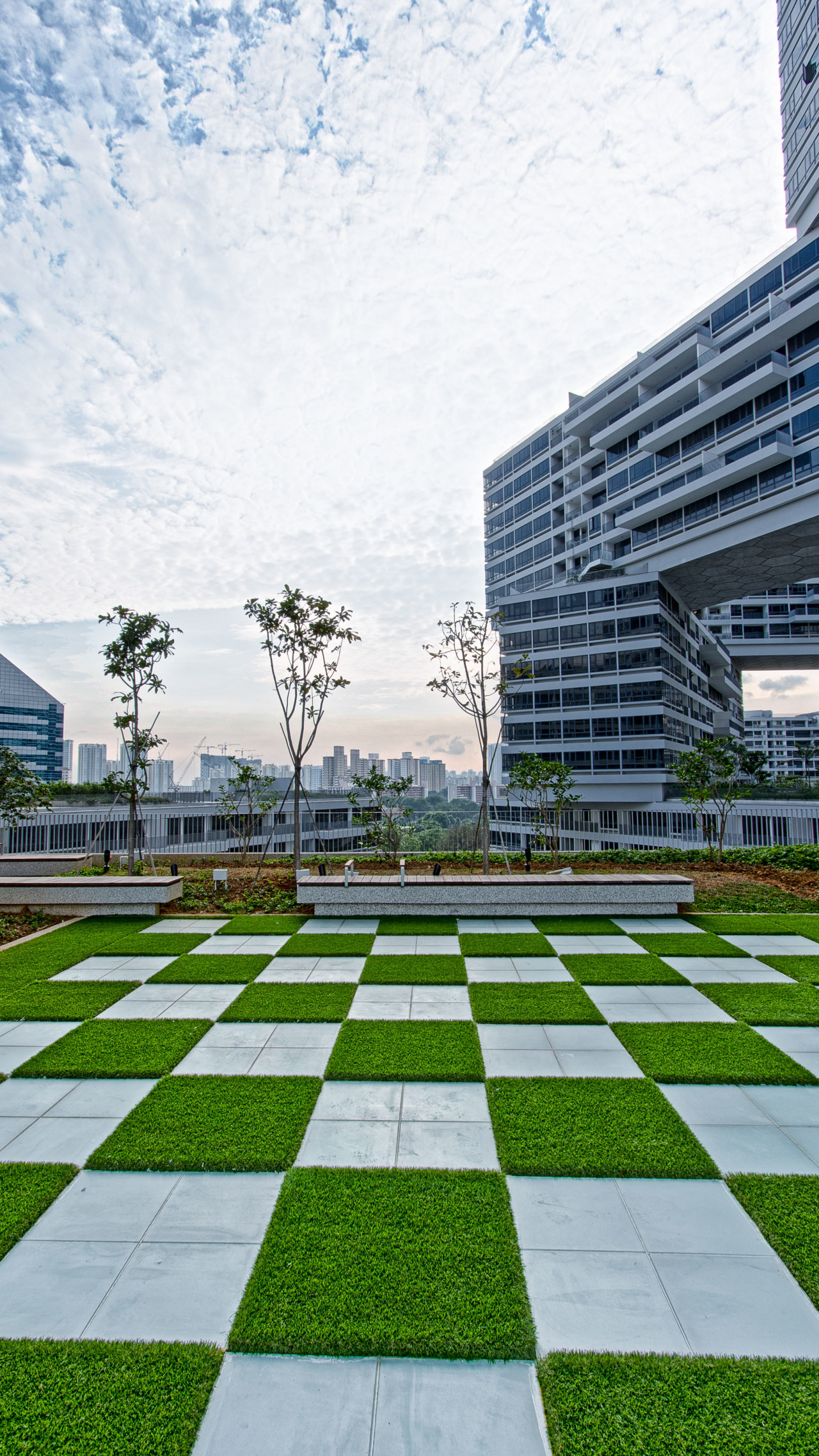Landscaped public areas at The Interlace apartments, Singapore architecture, building, campus, condominium, corporate headquarters, daytime, grass, headquarters, landmark, landscape, landscaping, lawn, line, metropolitan area, plant, real estate, residential area, sky, structure, urban area, urban design, walkway, gray, white