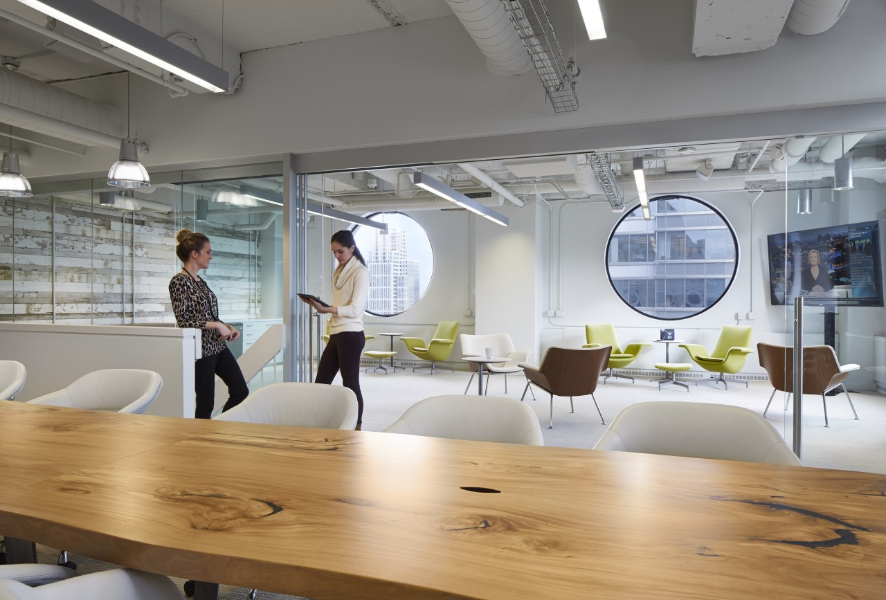 Large circular windows on the top floor of architecture, daylighting, furniture, interior design, office, product design, table, gray