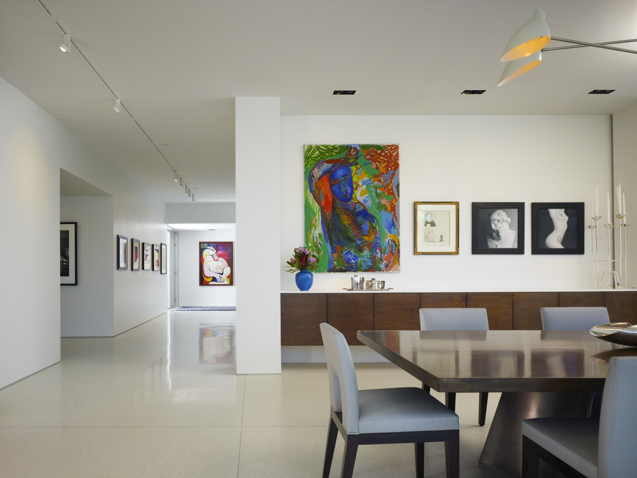 The large painting above the buffet in this art, art exhibition, art gallery, ceiling, exhibition, interior design, table, tourist attraction, gray