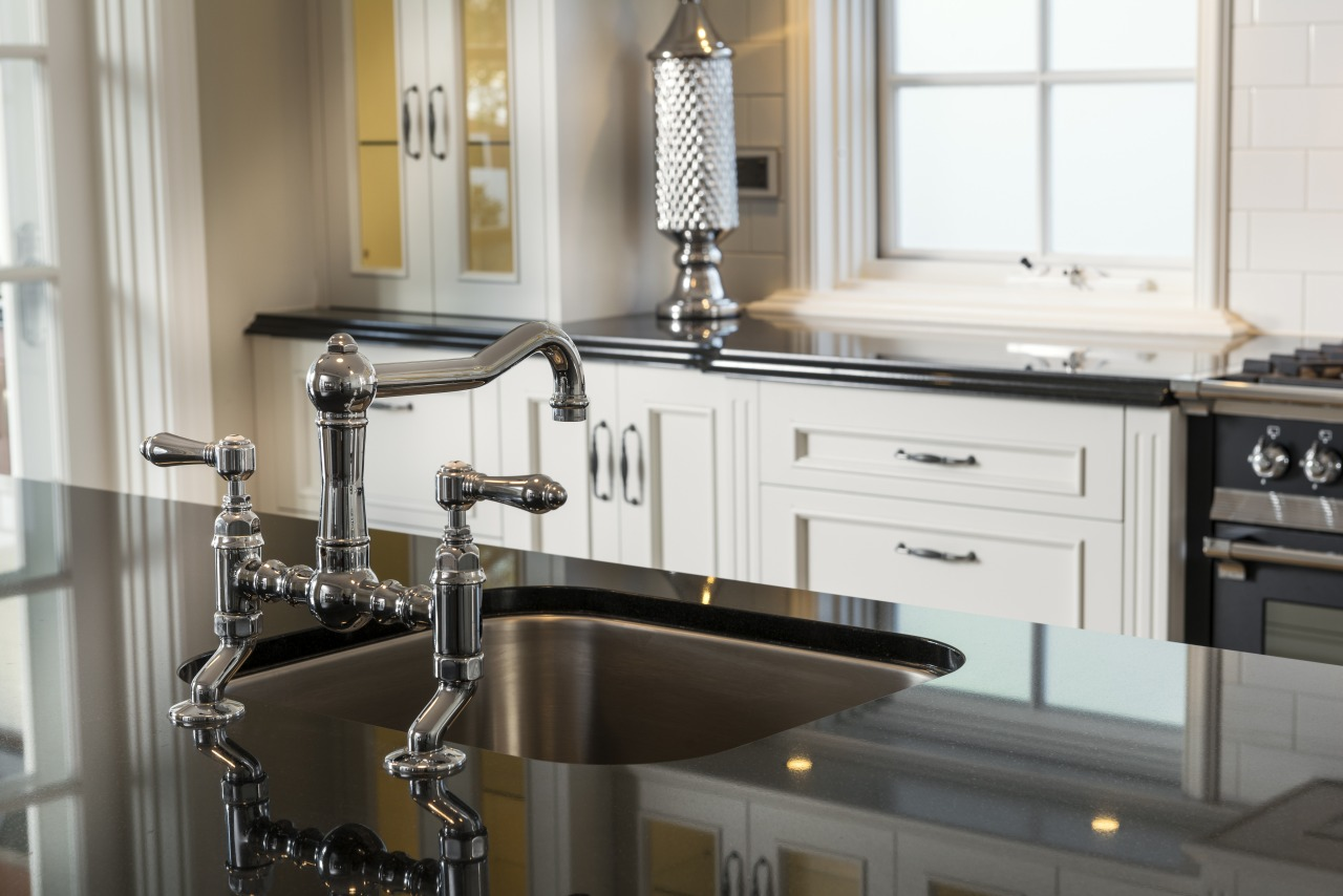 Traditional tapware enhances the old-world character of this cabinetry, countertop, cuisine classique, furniture, interior design, kitchen, sink, white