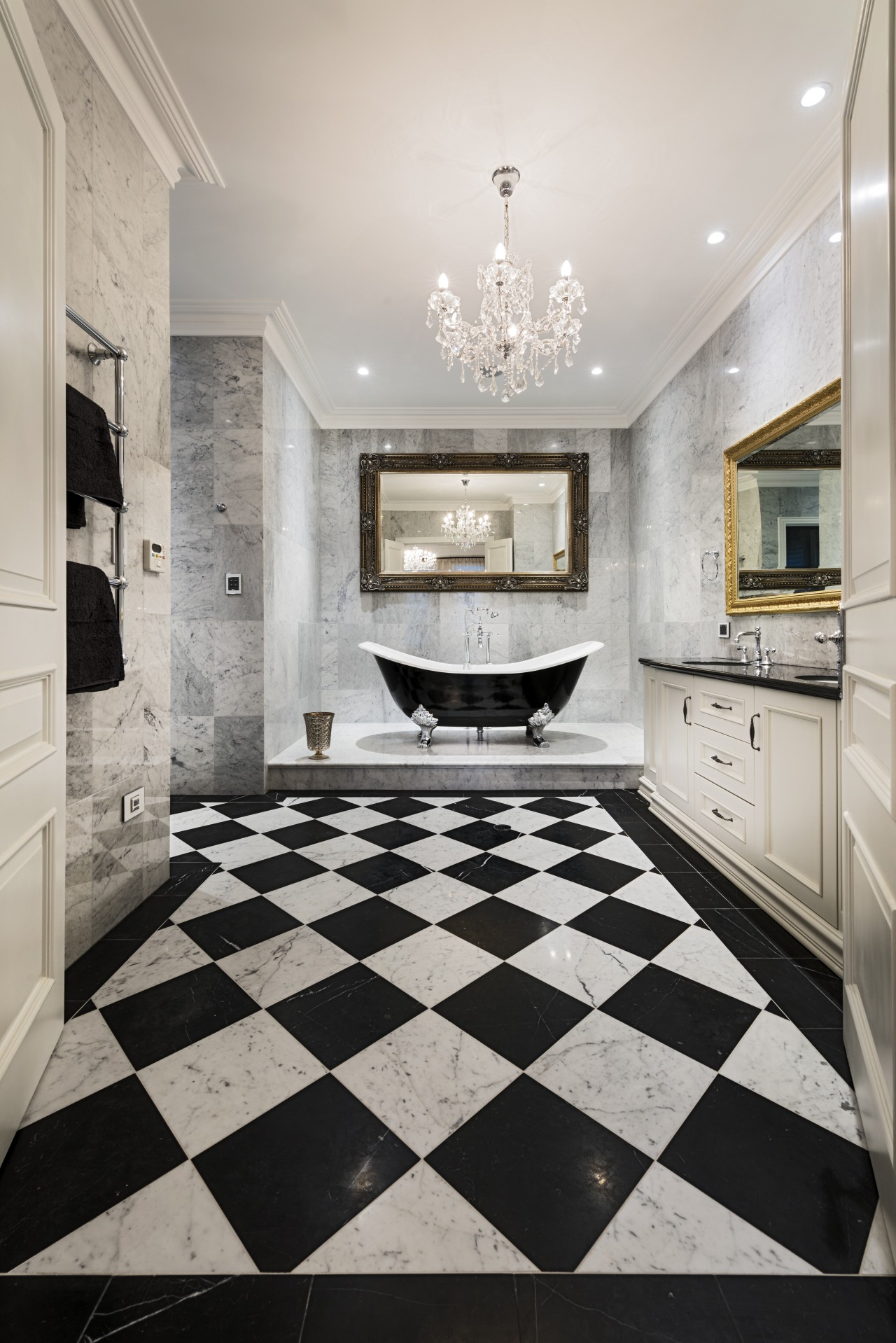All the walls in this master bathroom, including bathroom, ceiling, countertop, floor, flooring, home, interior design, living room, lobby, room, tile, wall, wood flooring, gray