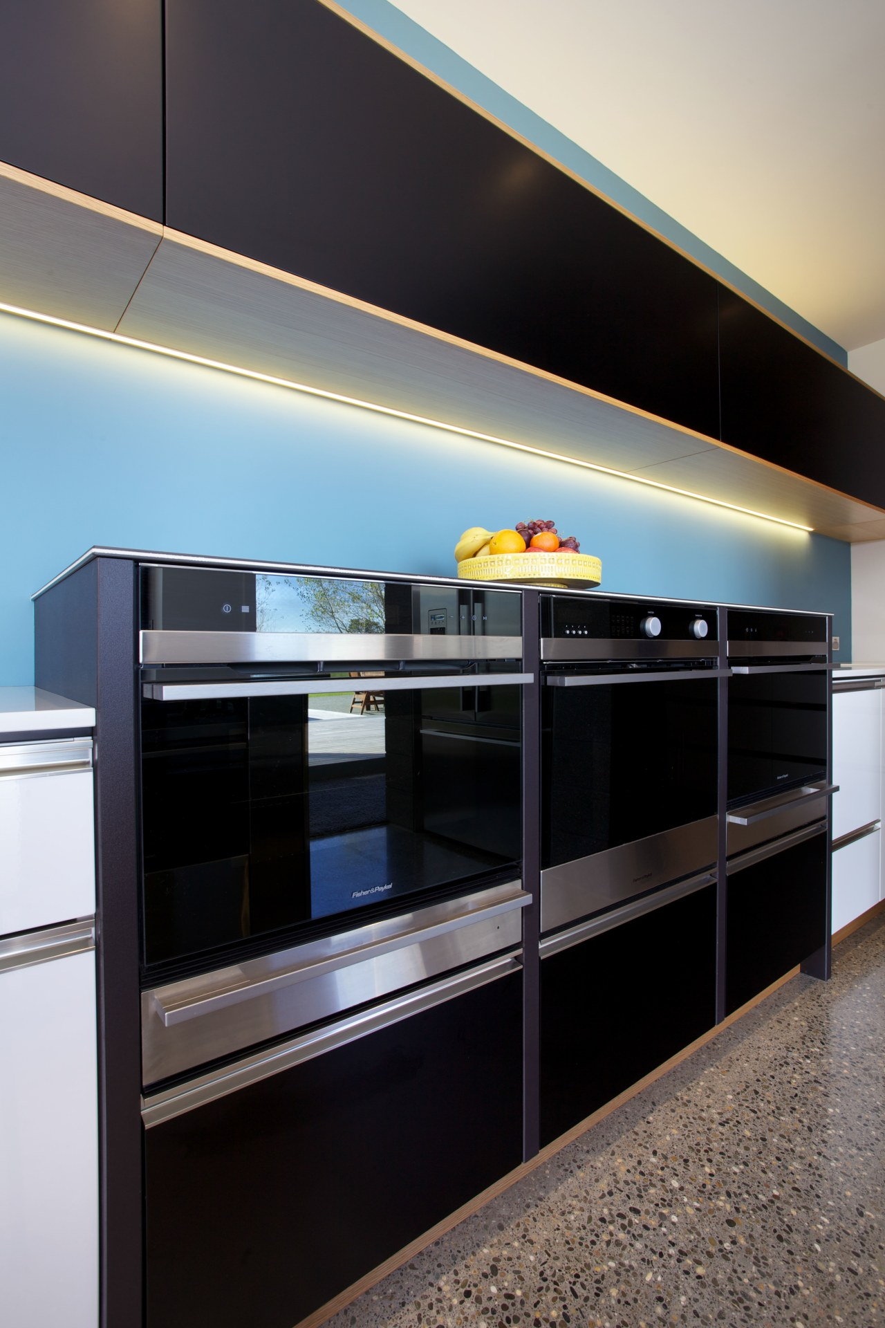 Modern kitchen with bank of Fisher & Paykel cabinetry, countertop, interior design, kitchen, shelving, black, gray
