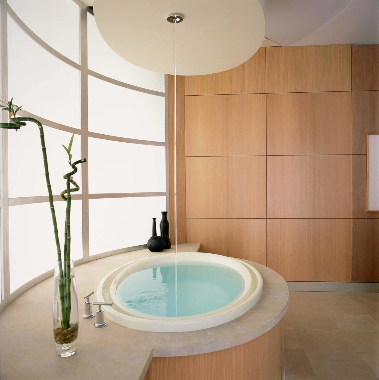 This round, built-in bathtub has a filler mounted bathroom, bathtub, ceiling, ceramic, floor, interior design, plumbing fixture, room, sink, tap, tile, white