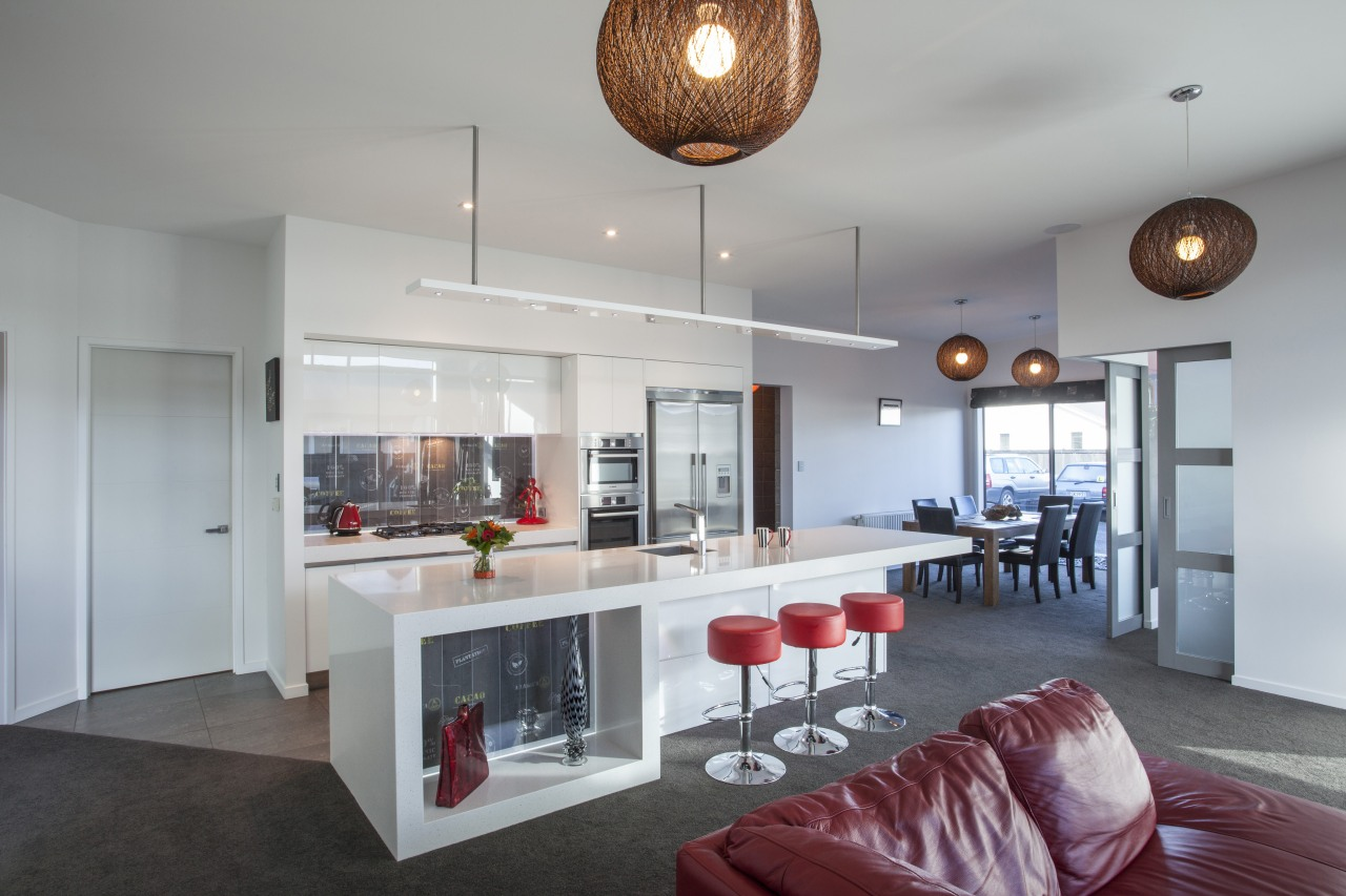 Sleek surfaces, white cabinets, red bar stools and interior design, kitchen, real estate, gray