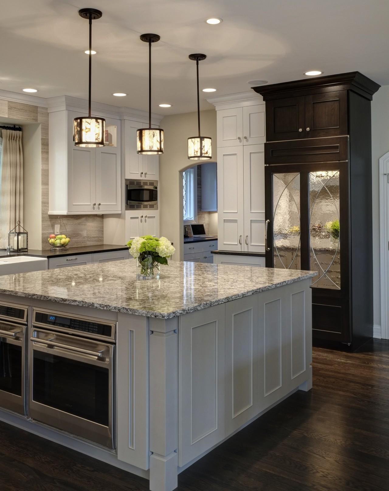 This kitchen design provides ample storage, including two cabinetry, countertop, cuisine classique, floor, flooring, hardwood, interior design, kitchen, room, wood flooring, gray, black