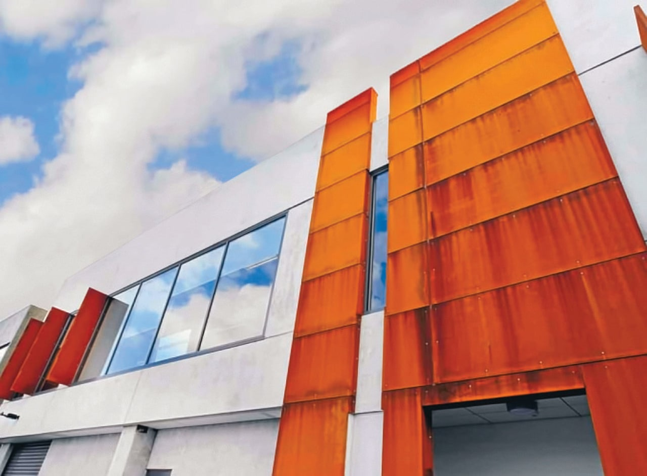 Corten steel facade on mixed use commercial development architecture, building, commercial building, corporate headquarters, daylighting, elevation, facade, line, orange, real estate, roof, sky, structure, window, white, red