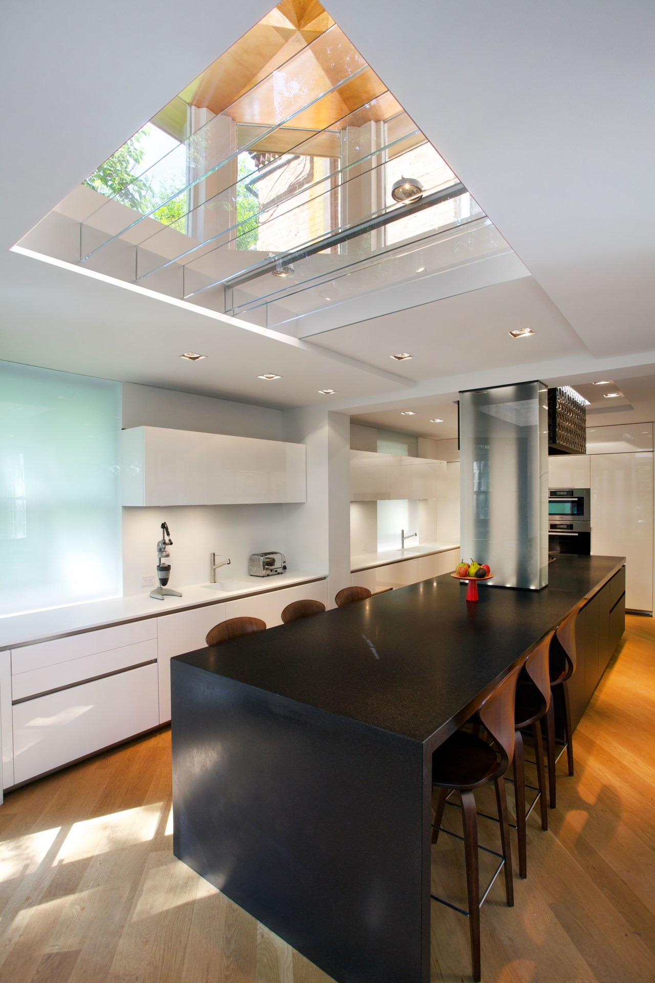 An existing lantern light above the island was architecture, ceiling, countertop, daylighting, house, interior design, kitchen, real estate, table, gray
