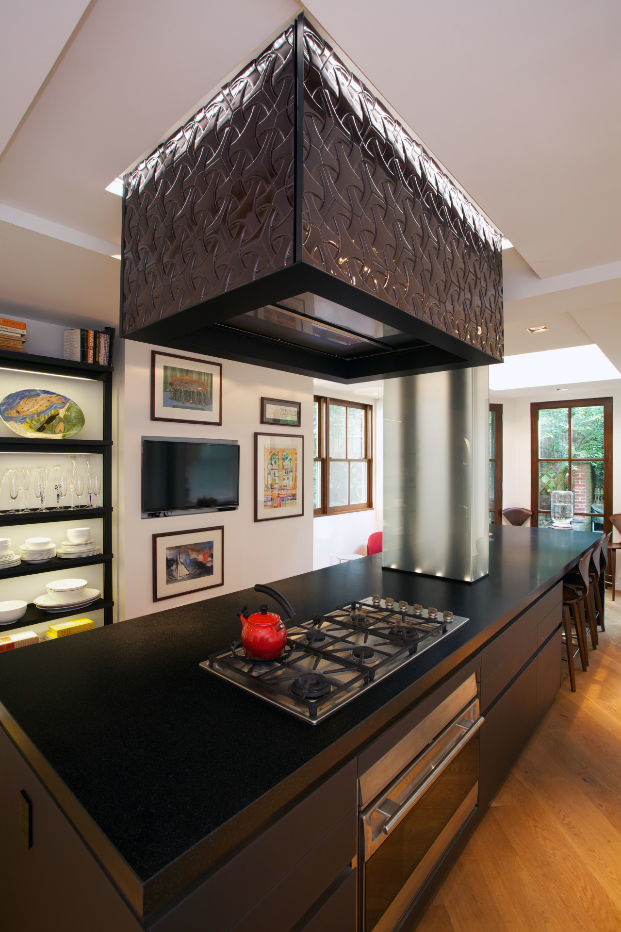 A custom tiled range hood is a key countertop, interior design, kitchen, room, black, gray