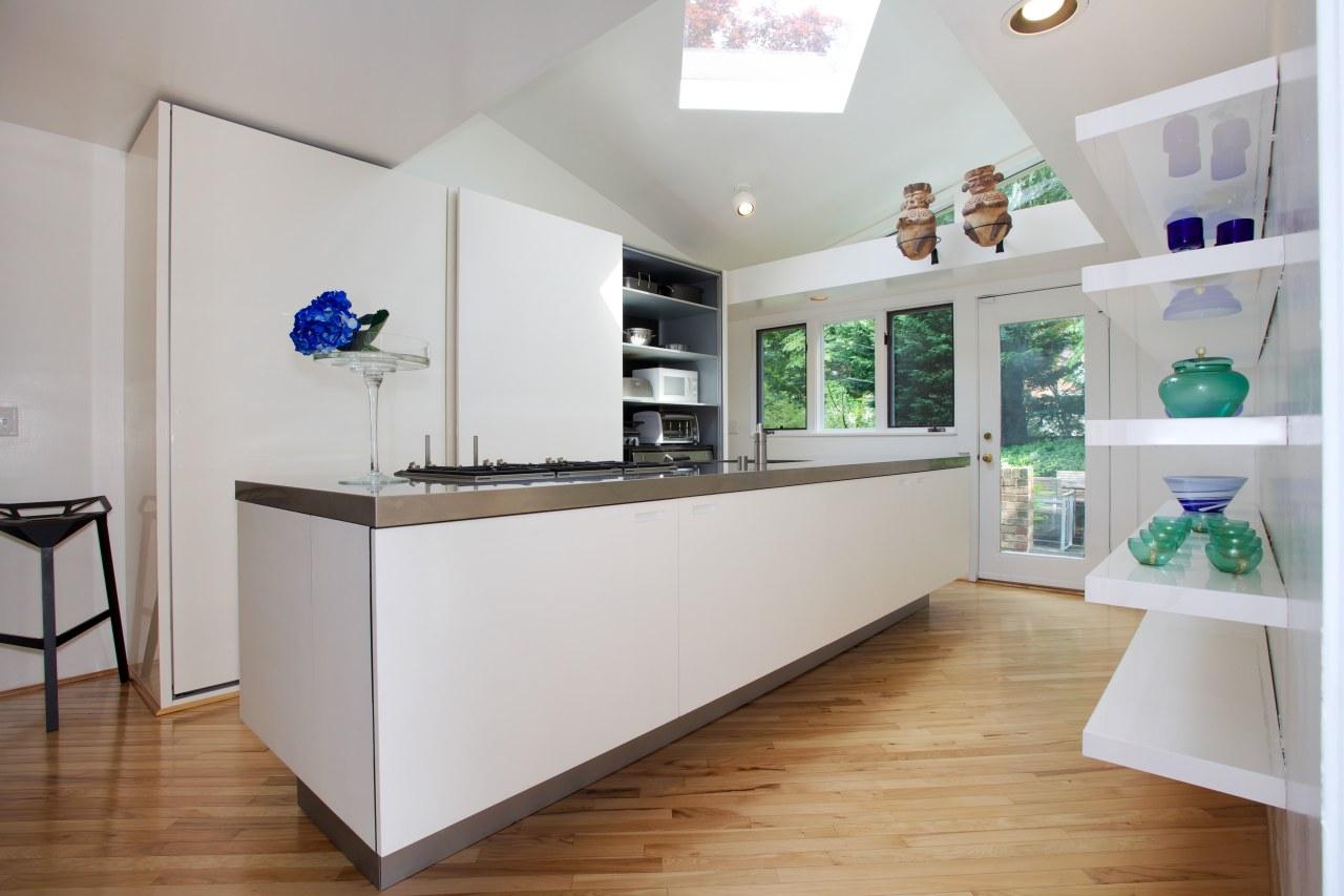Appliances are concealed in this minimalist galley kitchen interior design, kitchen, real estate, gray