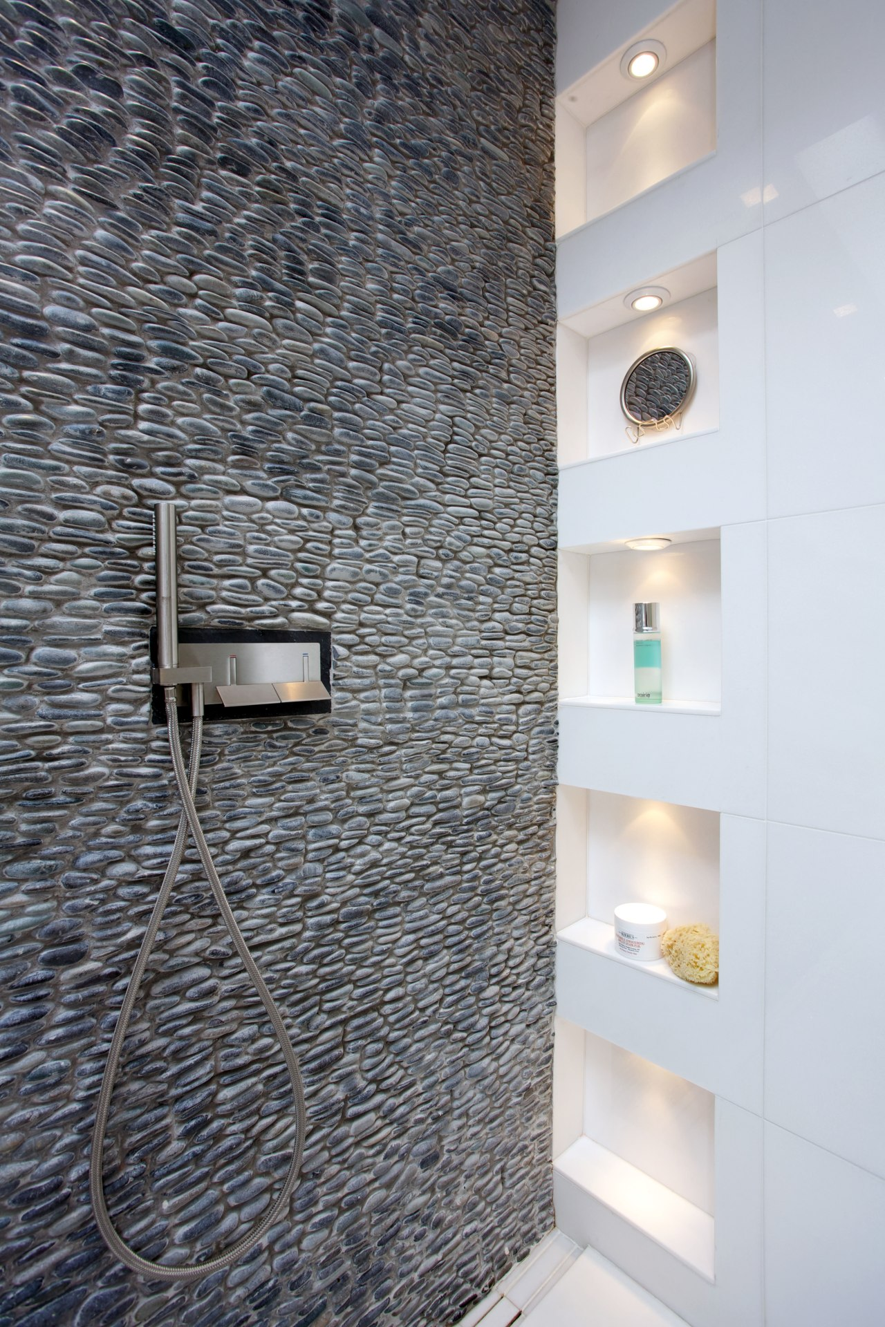 Wall-mounted faucets enhance the streamlined look of this bathroom, ceiling, floor, flooring, interior design, tile, wall, gray, white
