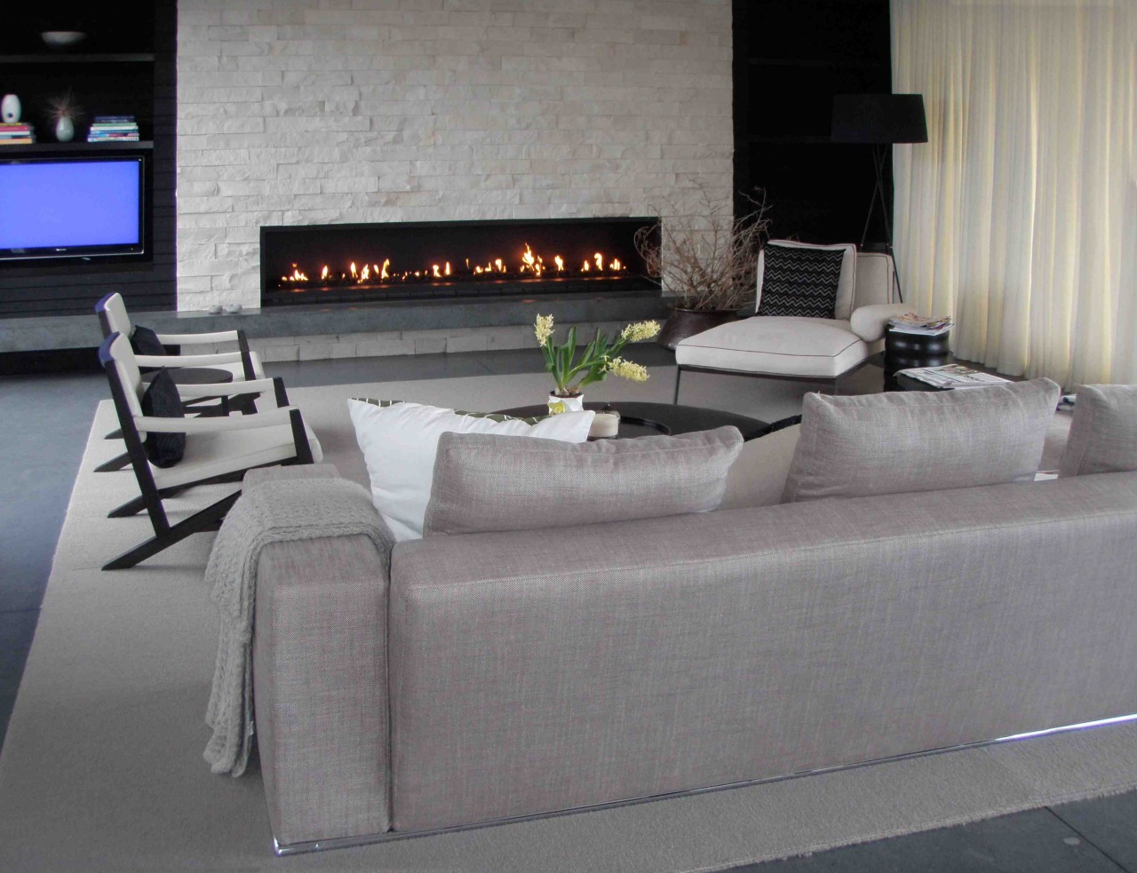 Eye-catching fireplaces are designed and constructed by architectural floor, flooring, furniture, interior design, living room, luxury vehicle, table, wall, gray