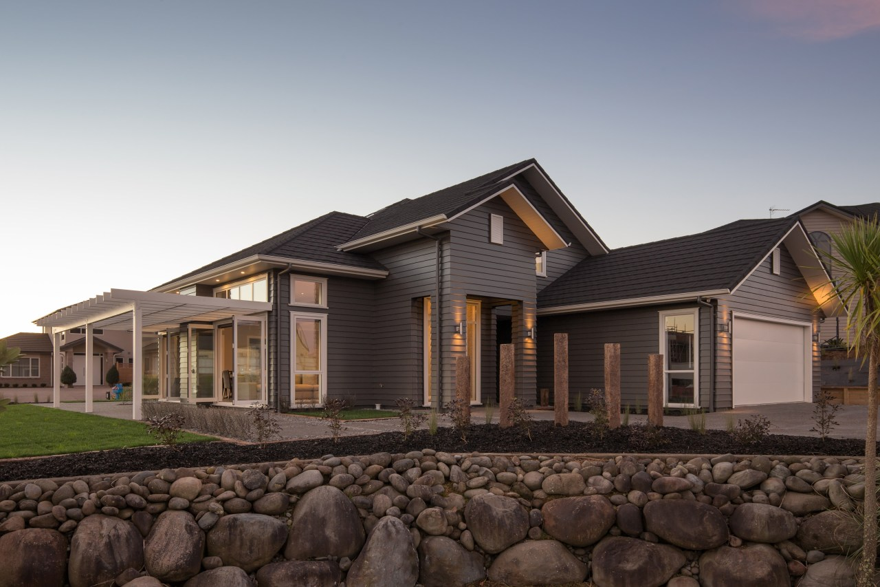This Landmark Homes family home, clad in James building, cottage, elevation, estate, facade, home, house, landscape, property, real estate, residential area, roof, siding, black, gray