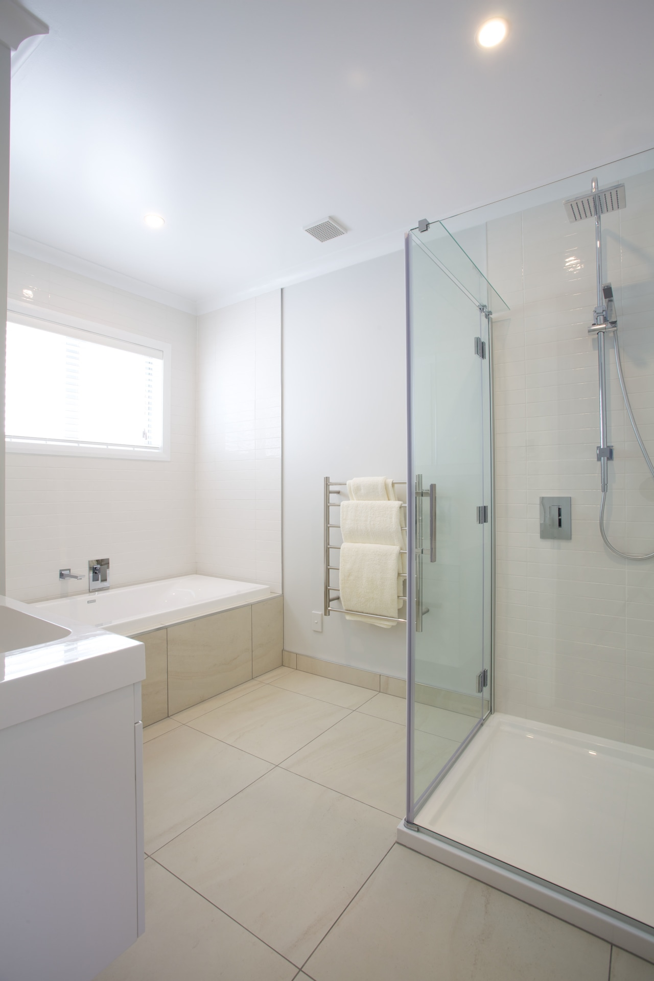 Sleek, contemporary bathrooms feature throughout this show home architecture, bathroom, ceiling, daylighting, floor, home, interior design, plumbing fixture, product design, property, real estate, room, tile, gray, white