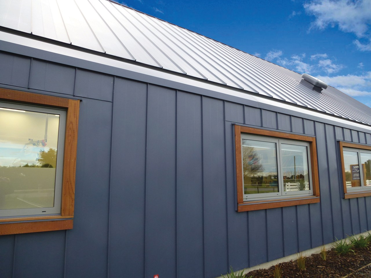 Heritage-Tray roofing by Calder Stewart provides new profile, facade, home, house, property, real estate, roof, shed, siding, window, blue, gray