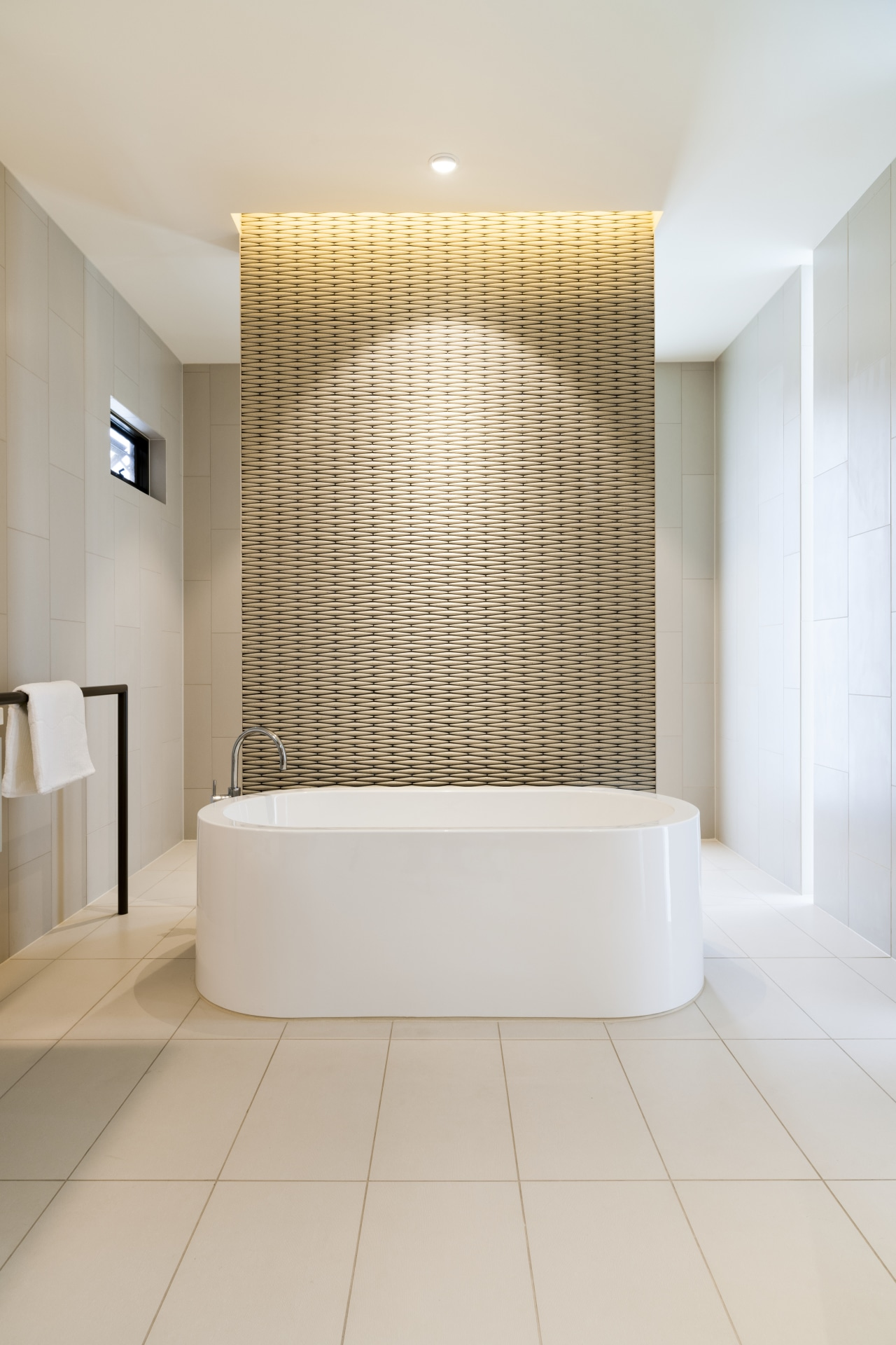 A freestanding bath with textured tilework on the architecture, bathroom, ceiling, daylighting, floor, flooring, interior design, room, tile, wall, gray