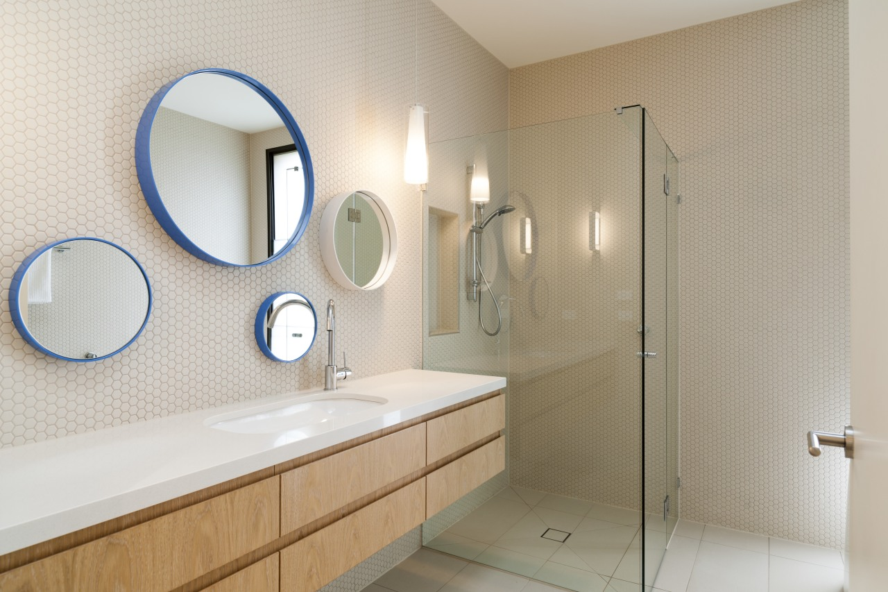 A clear glass shower stall optimises the sense bathroom, bathroom sink, floor, home, interior design, plumbing fixture, product design, room, sink, tile, gray