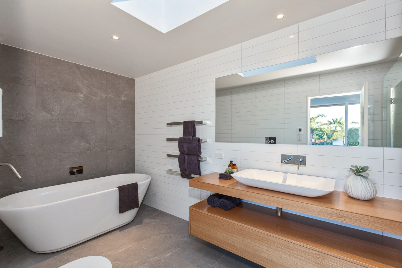 A floating timber vanity and large-format stone tiles architecture, bathroom, floor, home, interior design, real estate, room, sink, tile, gray
