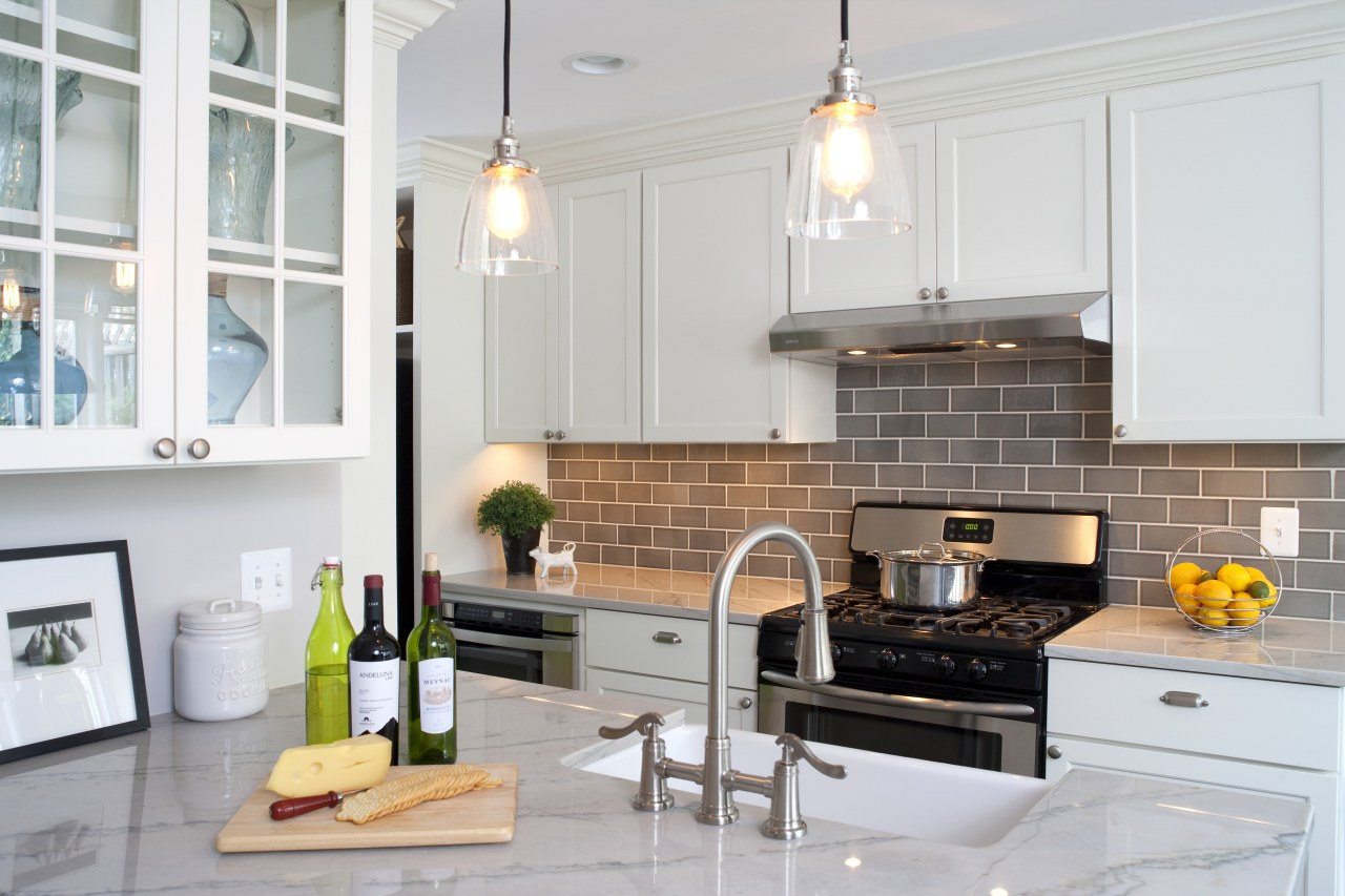 Gray tiles on the backsplash complement the white countertop, cuisine classique, home, interior design, kitchen, room, white