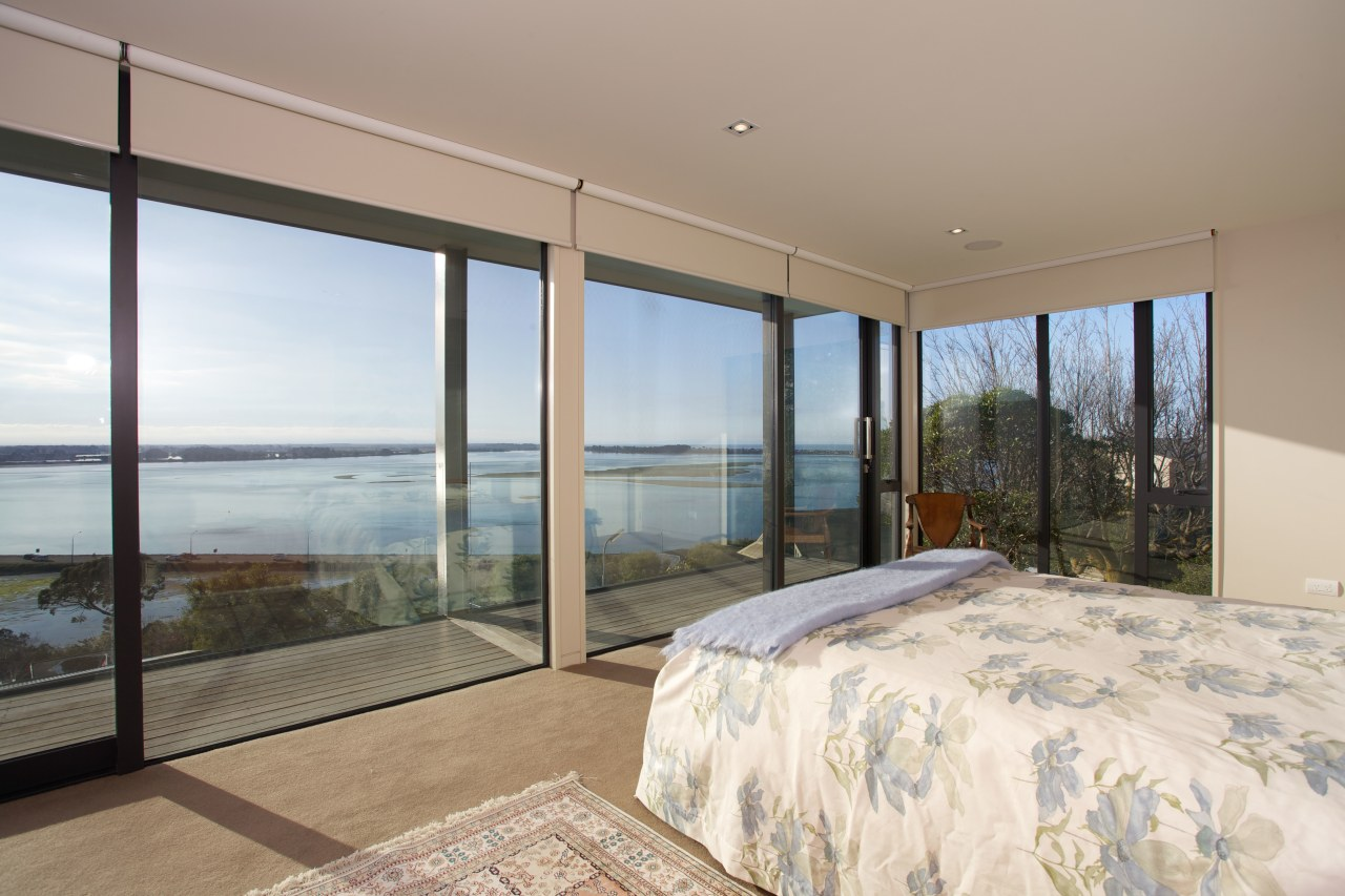 Contemporary master bedroom with sea views architecture, bedroom, condominium, door, estate, home, house, interior design, property, real estate, room, window, gray