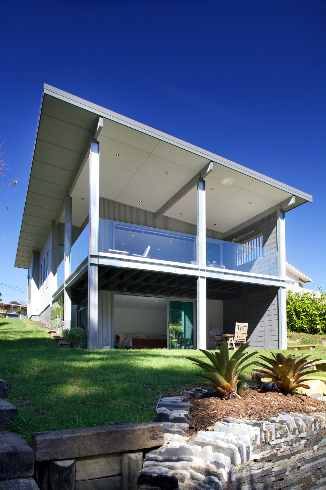 This 1950s bach has undergone a major transformation architecture, home, house, blue