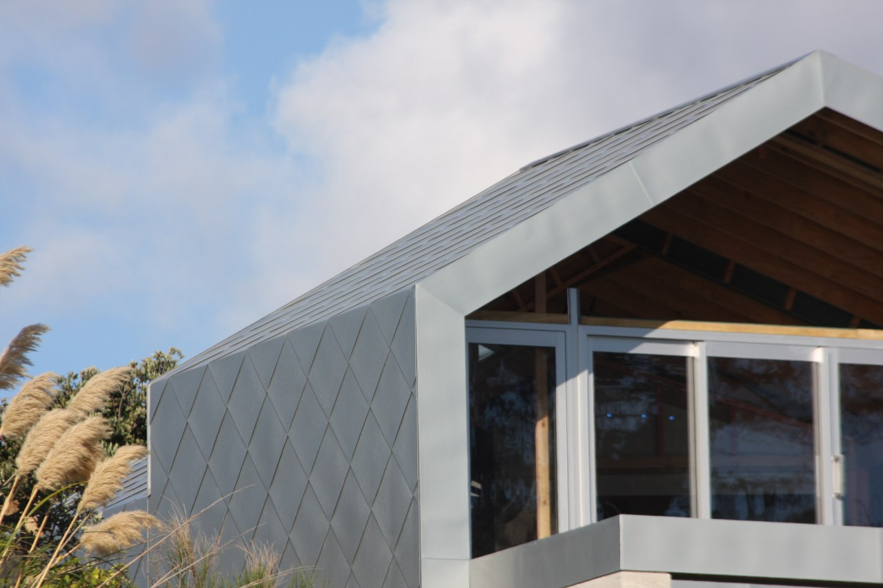 Large-format, individually handcrafted tile cladding from Eurometals wraps architecture, daylighting, facade, home, house, roof, siding, window, gray