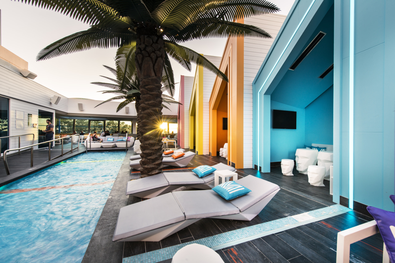 At this beachside venue, a row of cabanas estate, home, hotel, interior design, leisure, property, real estate, resort, swimming pool, vacation, villa, teal, white
