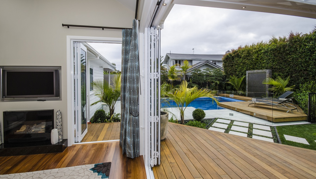 Smooth-running bifolds from Fairview Systems open up these backyard, balcony, daylighting, deck, house, interior design, property, real estate, window, gray